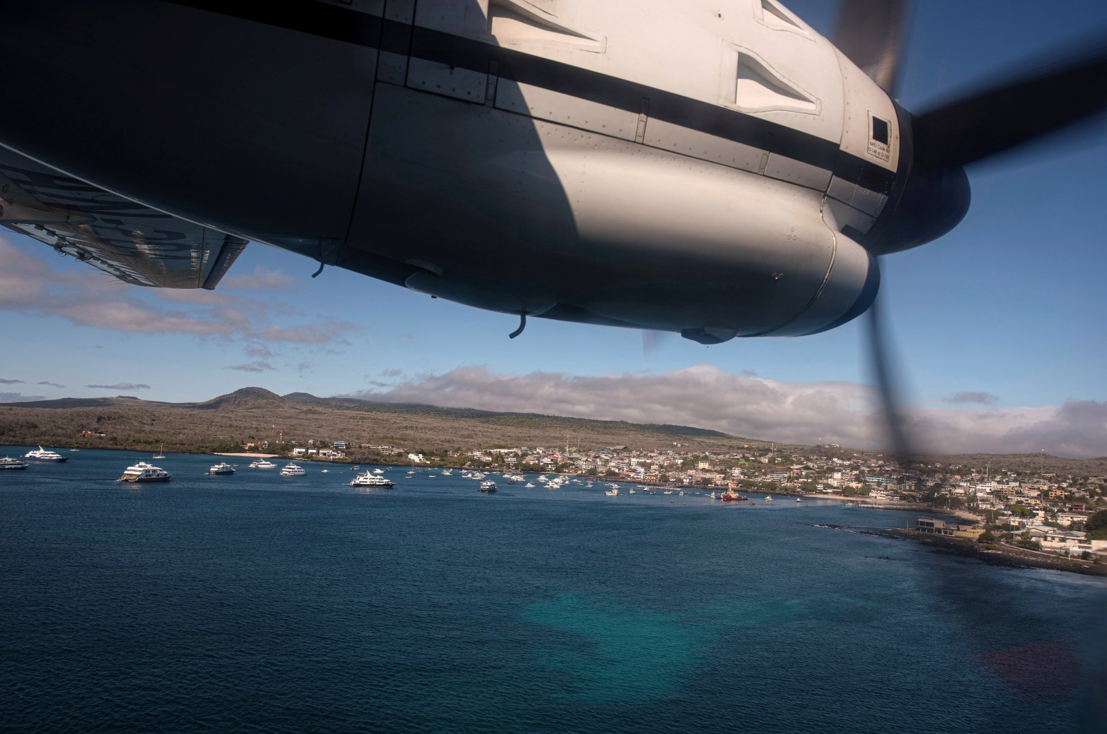 An Ecuadorian navy aircraft prepares to land in San Cristobal after a fishing fleet of mostly Chinese-flagged ships was detected in an international corridor that borders the Galapagos Islands' exclusive economic zone, in San Cristobal, Galapagos Islands, Ecuador, Aug. 7, 2020. (REUTERS/Santiago Arcos)