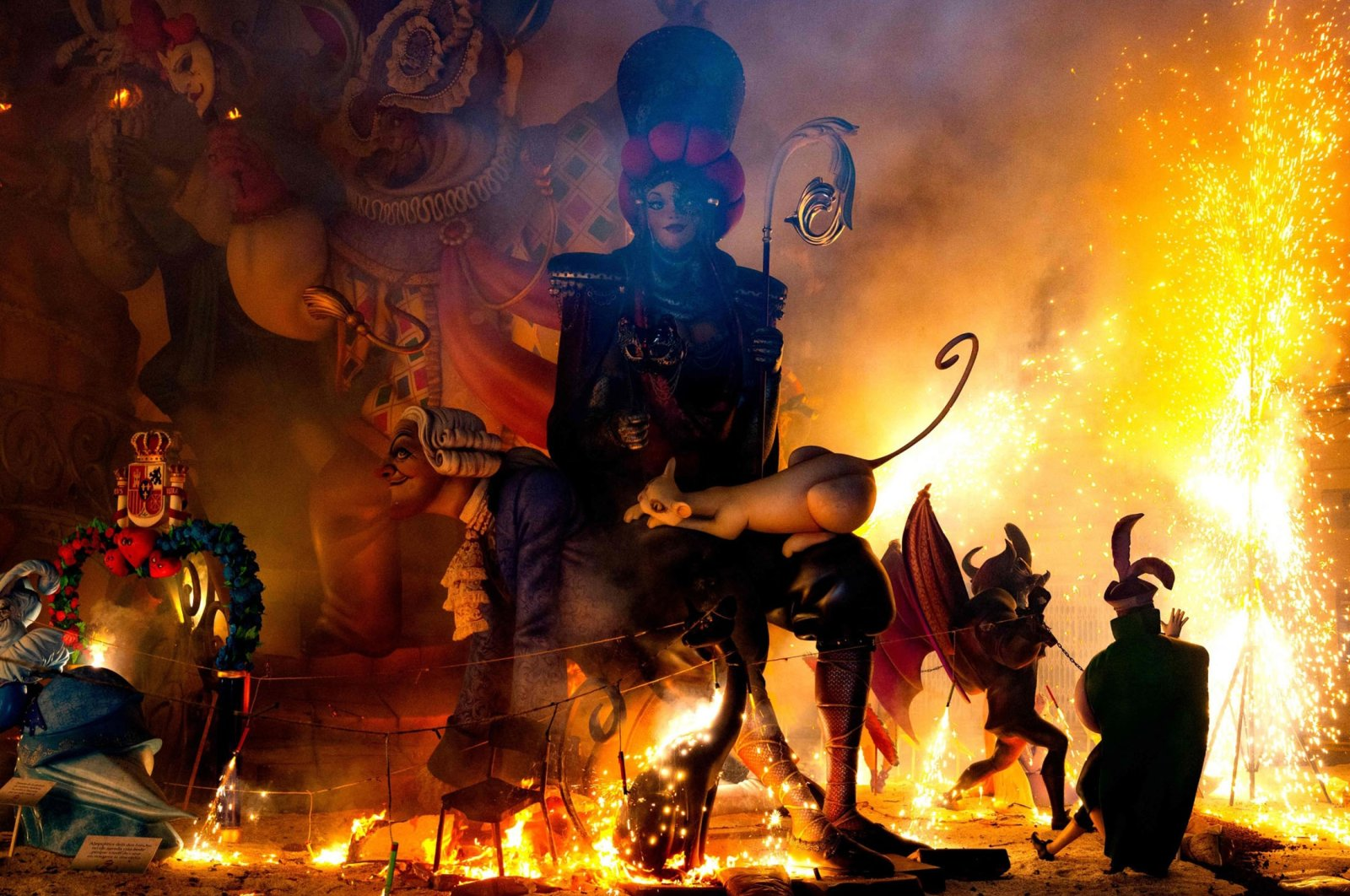 Ninots (cardboard figurines) burn as one installation of the Fallas Festival is set on fire in Valencia, Spain, Sept. 5, 2021. (AFP Photo)