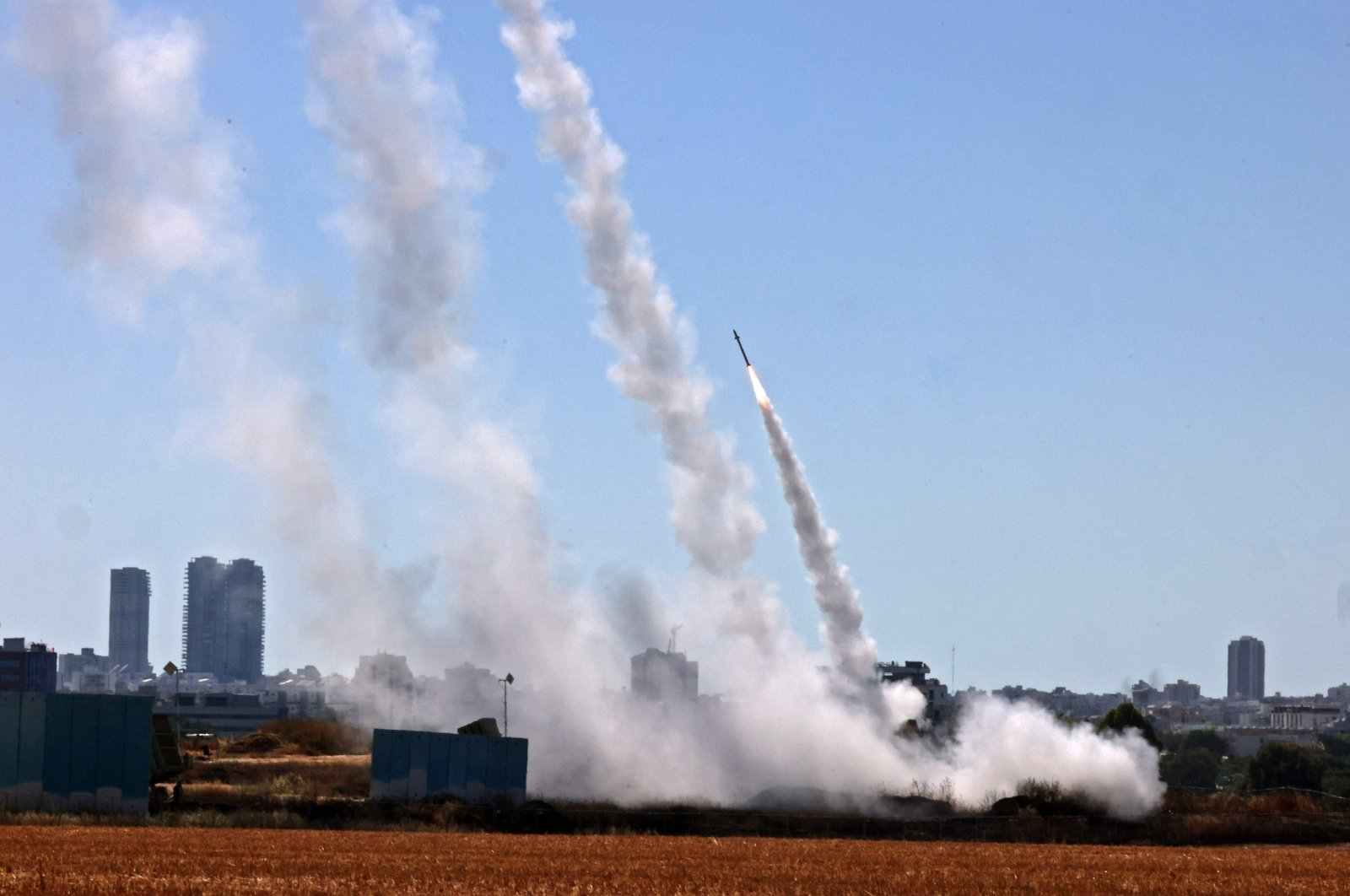 Israel's Iron Dome aerial defence system is activated to intercept a rocket launched from the Gaza Strip, controlled by the Palestinian Hamas movement, above the southern Israeli city of Ashdod, on May 12, 2021. (AFP Photo)