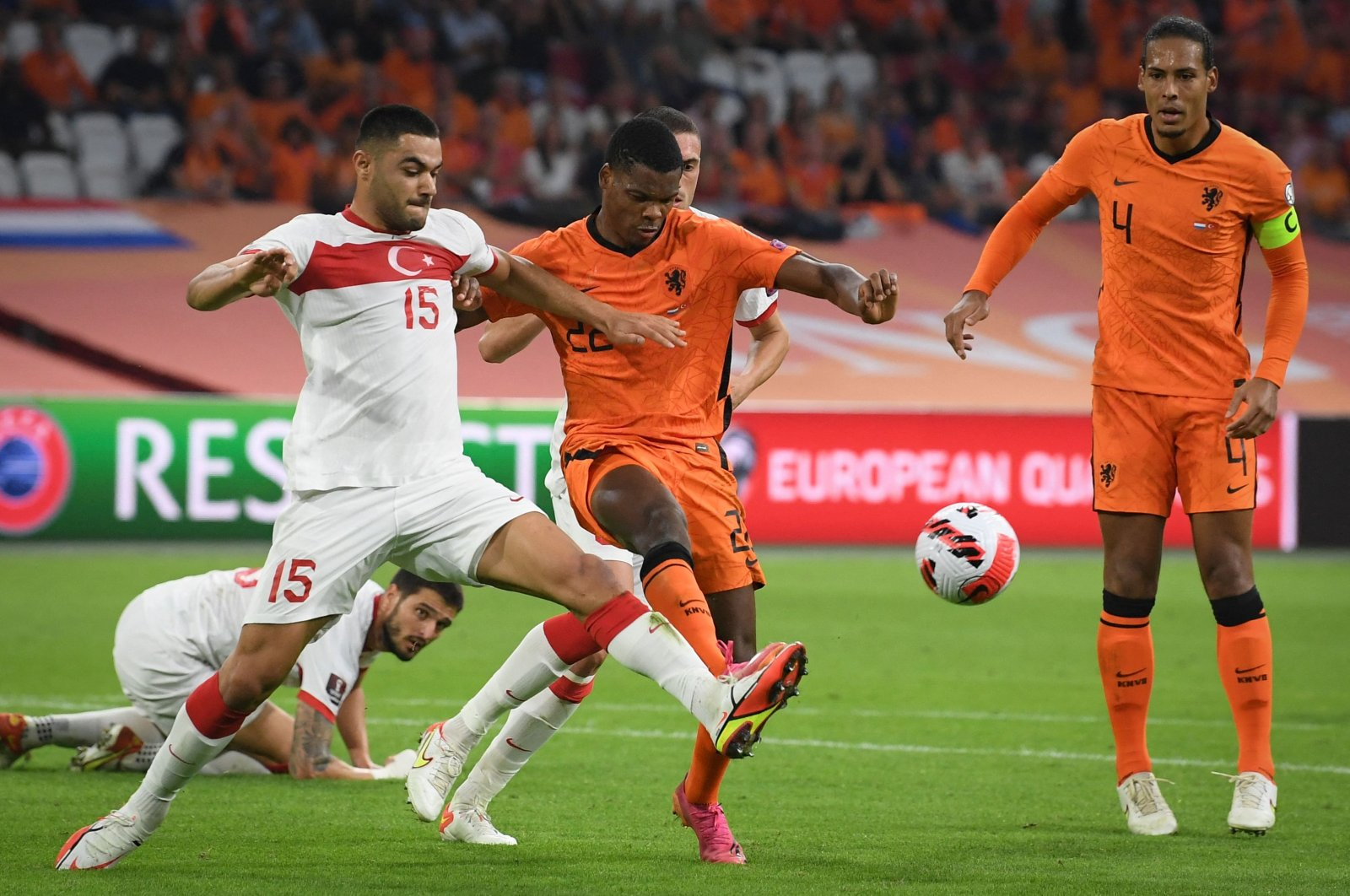 Turkey's defender Ozan Kabak (L) fights for the ball with Netherlands' defender Denzel Dumfries (C) during the FIFA World Cup Qatar 2022 qualifying round Group G football match between The Netherlands and Turkey at the Johan Cruijff Arena stadium in Amsterdam, the Netherlands, on Sept. 7, 2021. (AFP Photo)
