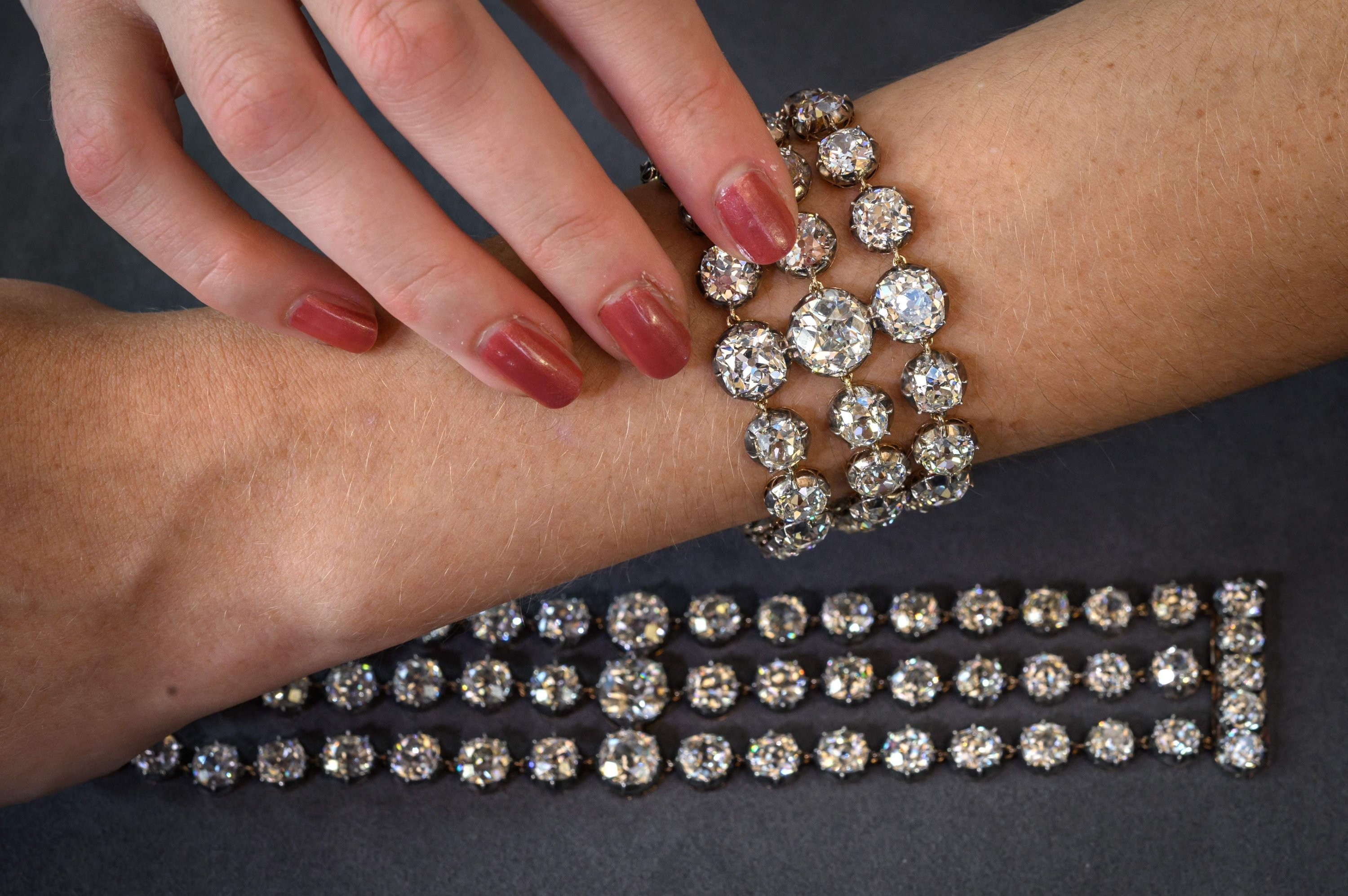 This picture taken in Geneva on Sep. 6, 2021 shows two bracelets belonged to French Queen Marie-Antoinette adorned with three rows of 112 old cut diamonds. (AFP Photo)