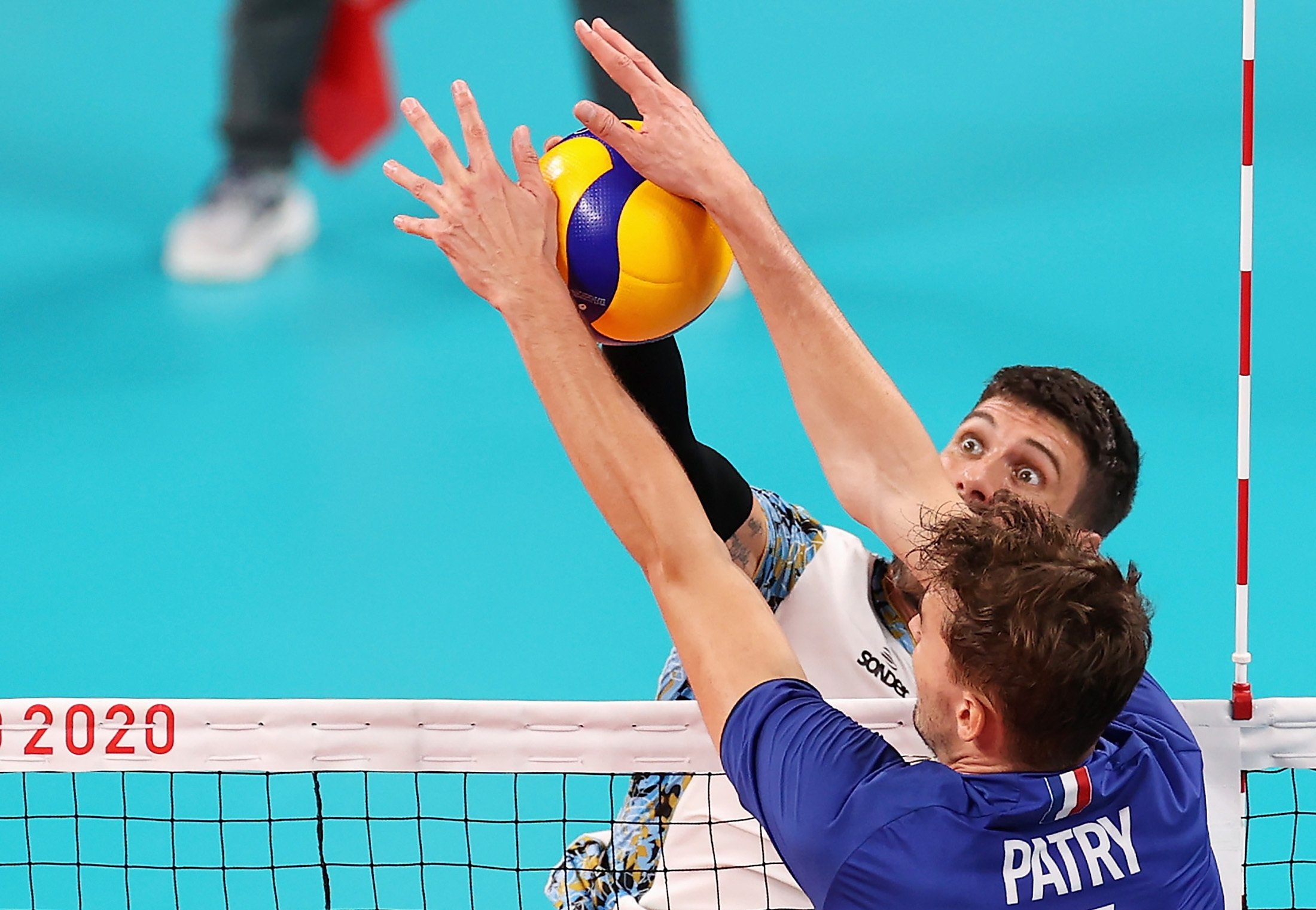 Facundo Conte #7 of Team Argentina competes against Jean Patry #4 of Team France during the Men's Volleyball Semifinals on day thirteen of the Tokyo 2020 Olympic Games at Ariake Arena in Tokyo, Japan, Aug. 5, 2021. (Getty Images Photo)