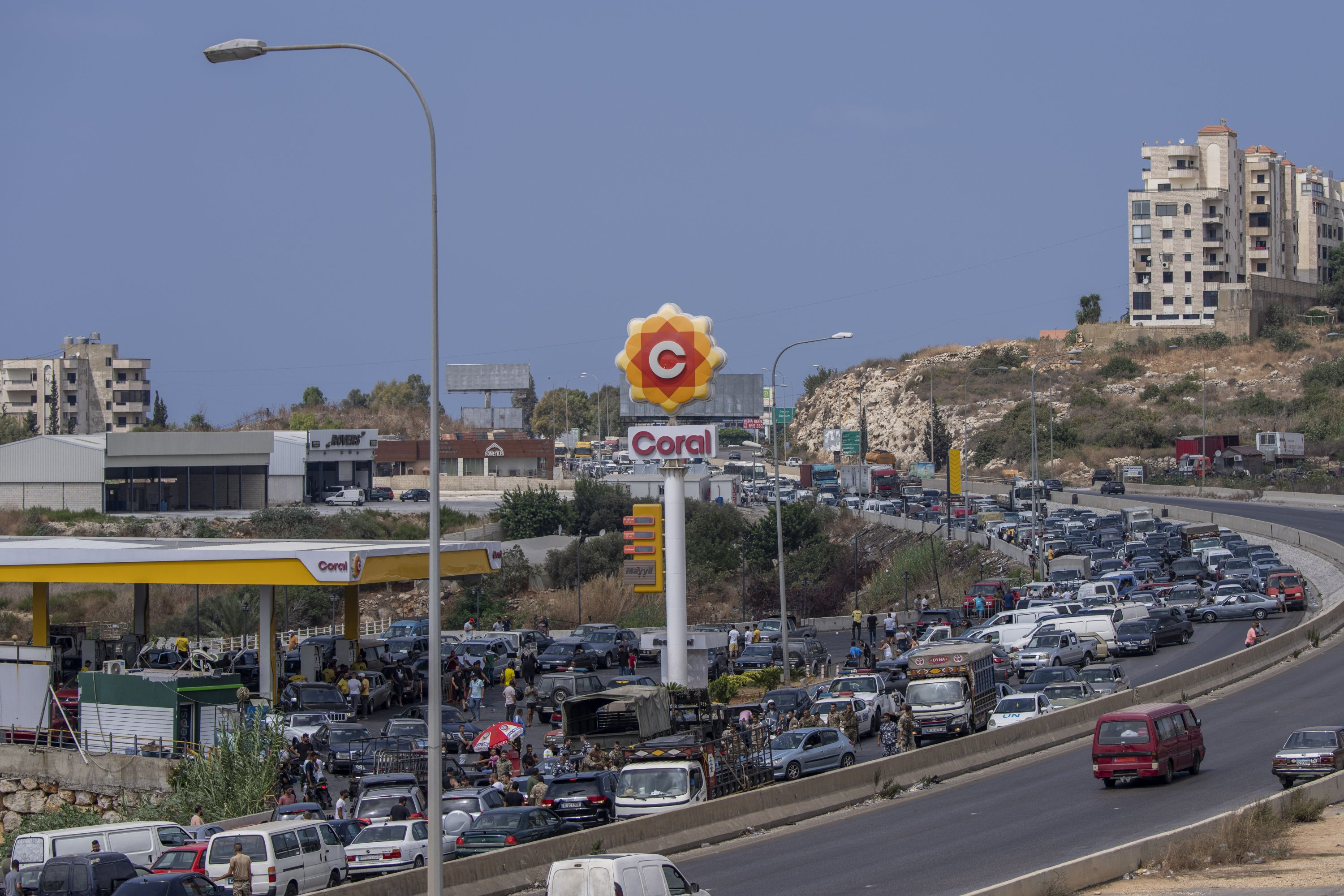 General view of a gas station on the main highway that connects the capital Beirut with southern Lebanon as cars come from all directions to try to fill their gas tanks, in the coastal town of Jiyeh, to the south from Beirut, Lebanon, on September 3, 2021. (AP Photo)