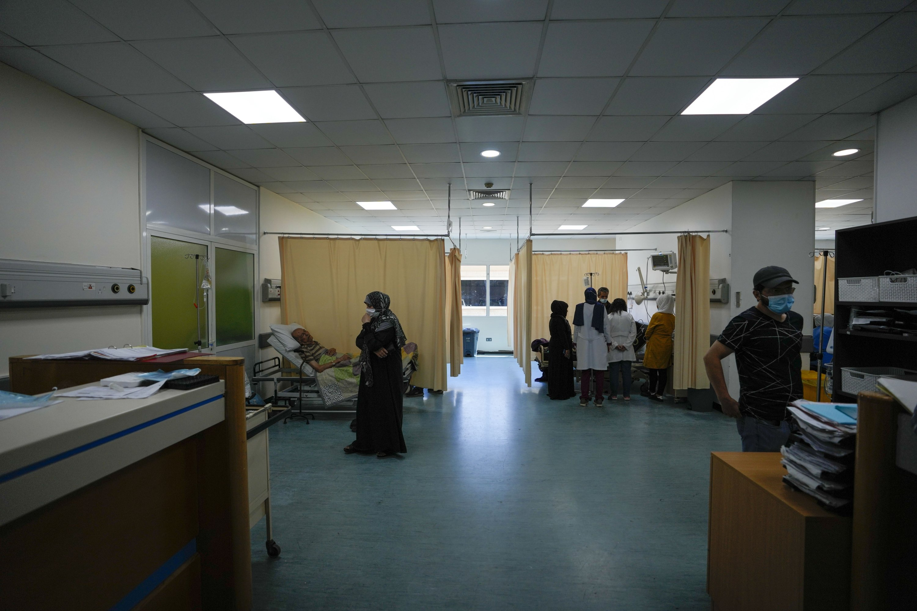 Patients are treated inside the emergency room at the government-run Rafik Hariri University Hospital in Beirut, Lebanon, August 11, 2021. (AP Photo)
