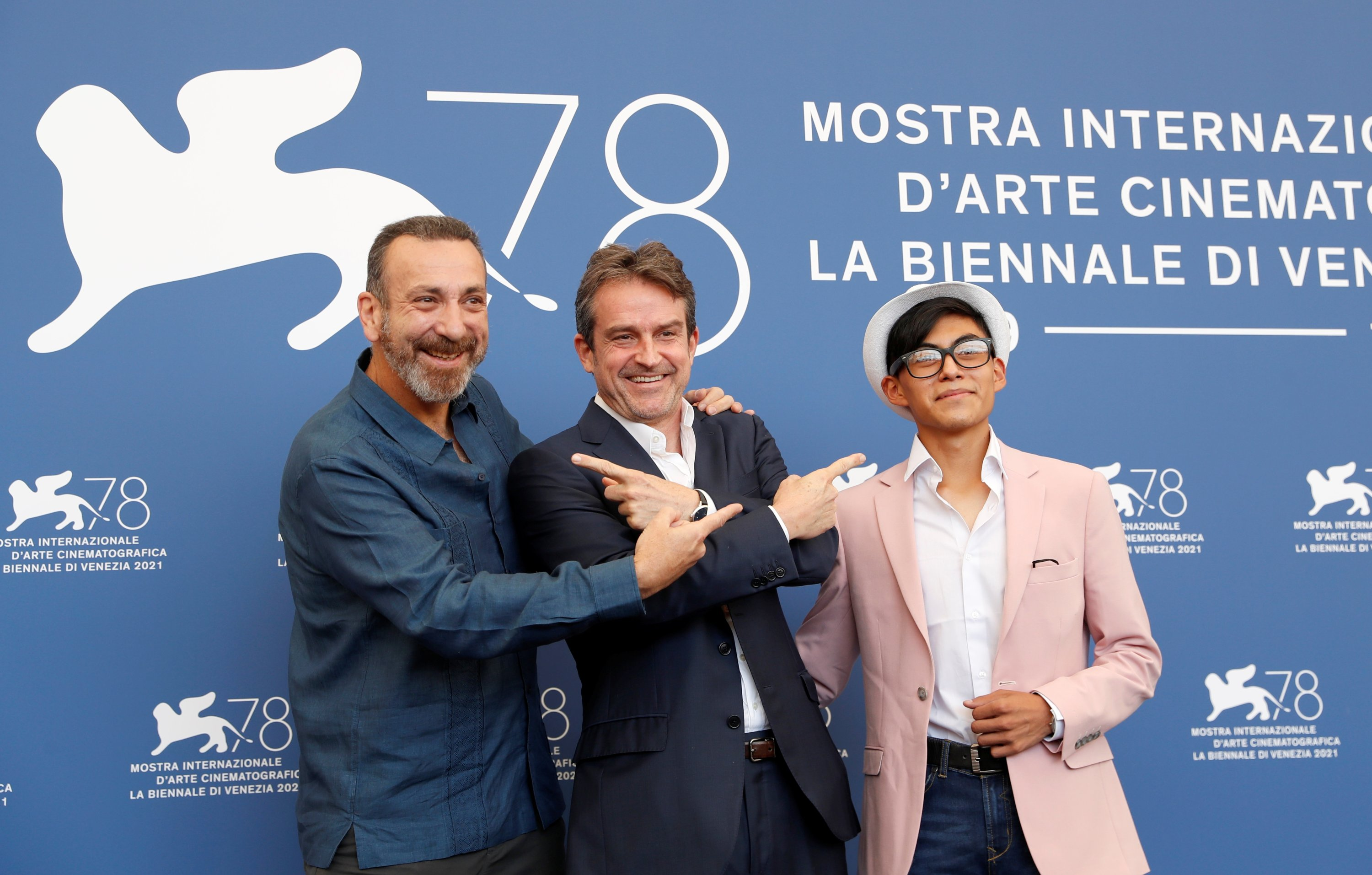 Director Lorenzo Vigas (C) and actors Hernan Mendoza (L) and Hatzin Navarrete pose during a photocall for the film 'The Box' at the 78th Venice Film Festival, Venice, Italy. (Reuters Photo)