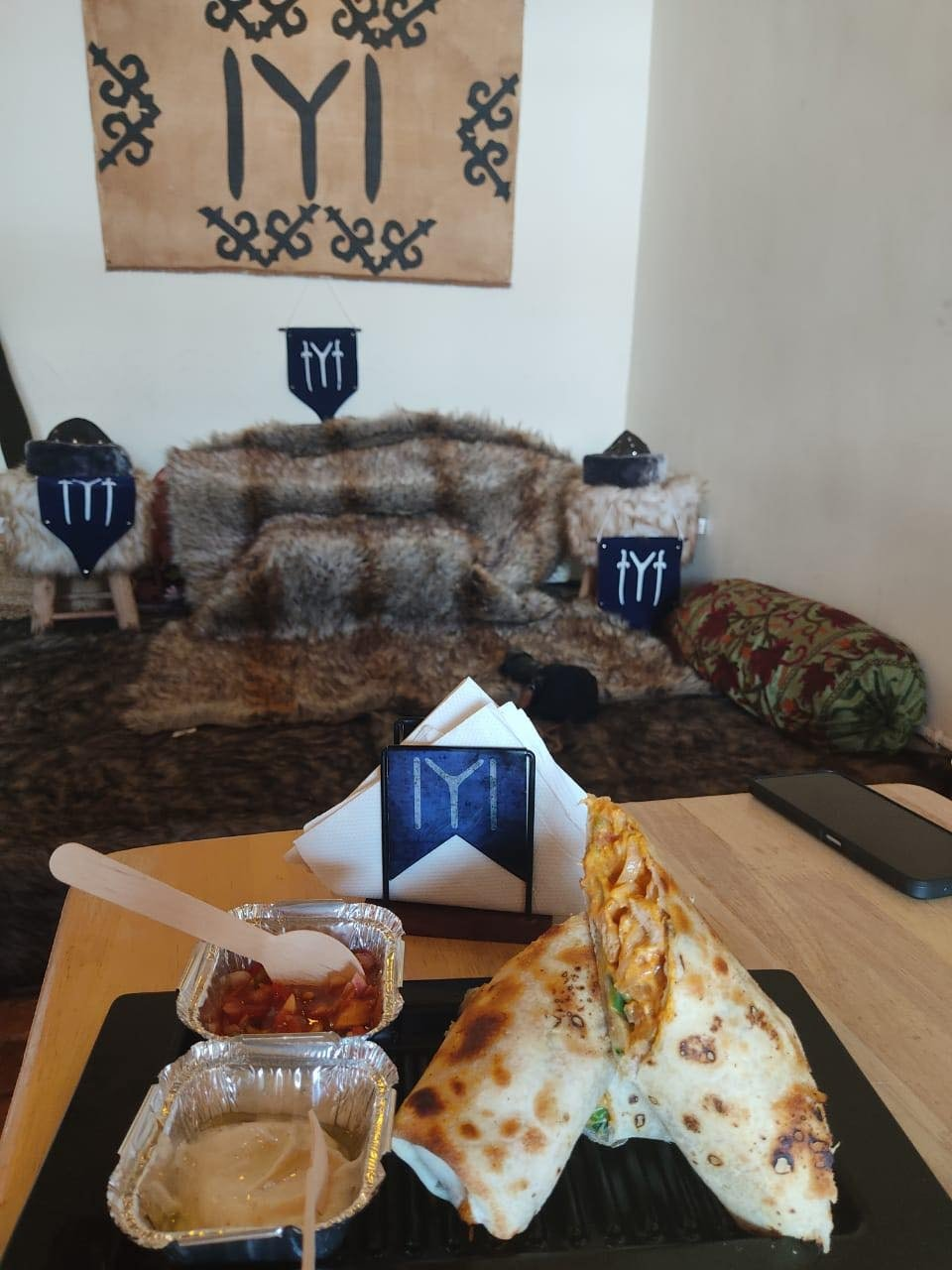 A dürüm is served at Kardeşler - The Kashmir Café in the view of a throne covered with fur and Kayı Tribe flags. (Photo Courtesy of Shadab Chashoo)