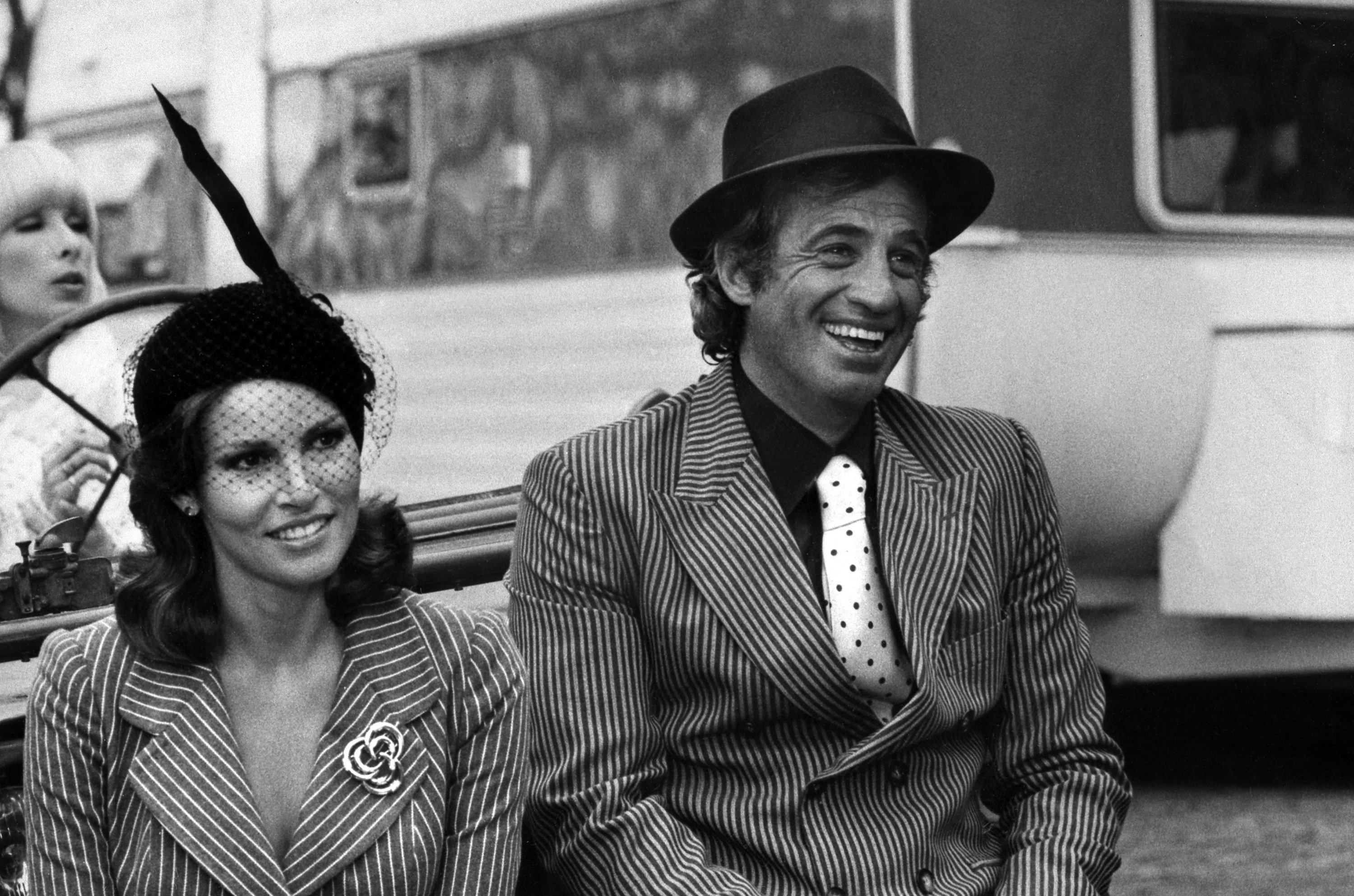 Jean-Paul Belmondo and U.S. actor Raquel Welch during the filming of 'Animal' directed by Claude Zidi in Paris, France, Jan. 1, 1977. (AFP File Photo)