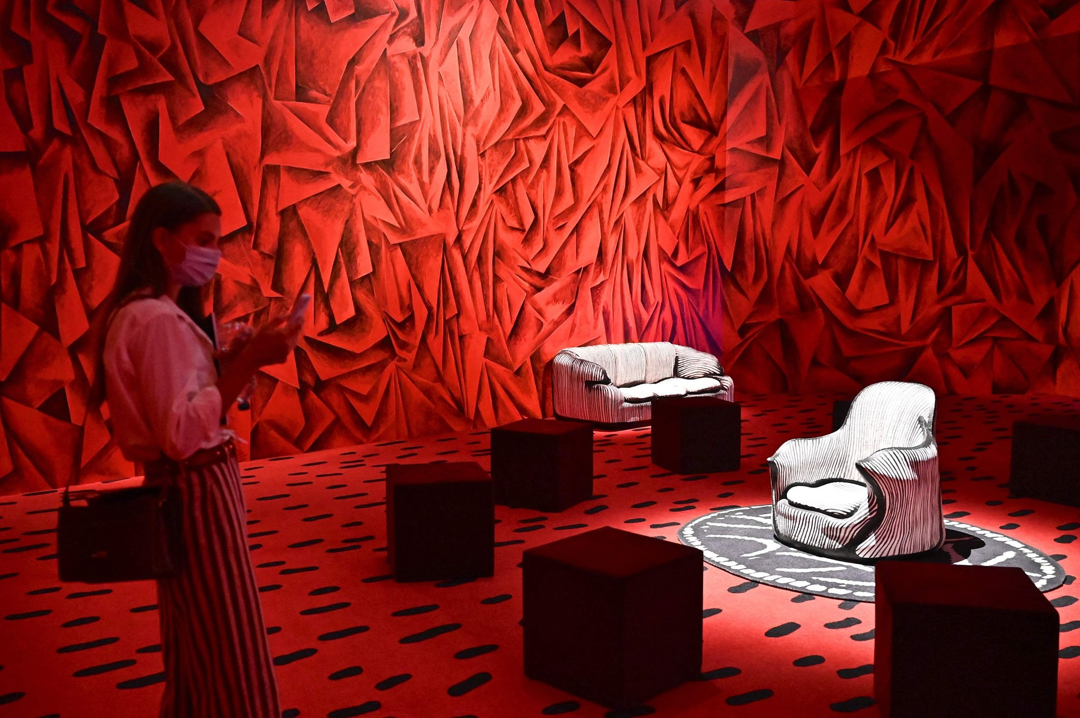 A visitor looks at Davidis Living Room Revisited by artists Guillermo Kuitca and David Lynch at the Les Citoyens by Cartier Foundation during the Fuorisalone 2021 in Triennale Museum, in Milan, Italy, Sept. 4, 2021. (AFP Photo)