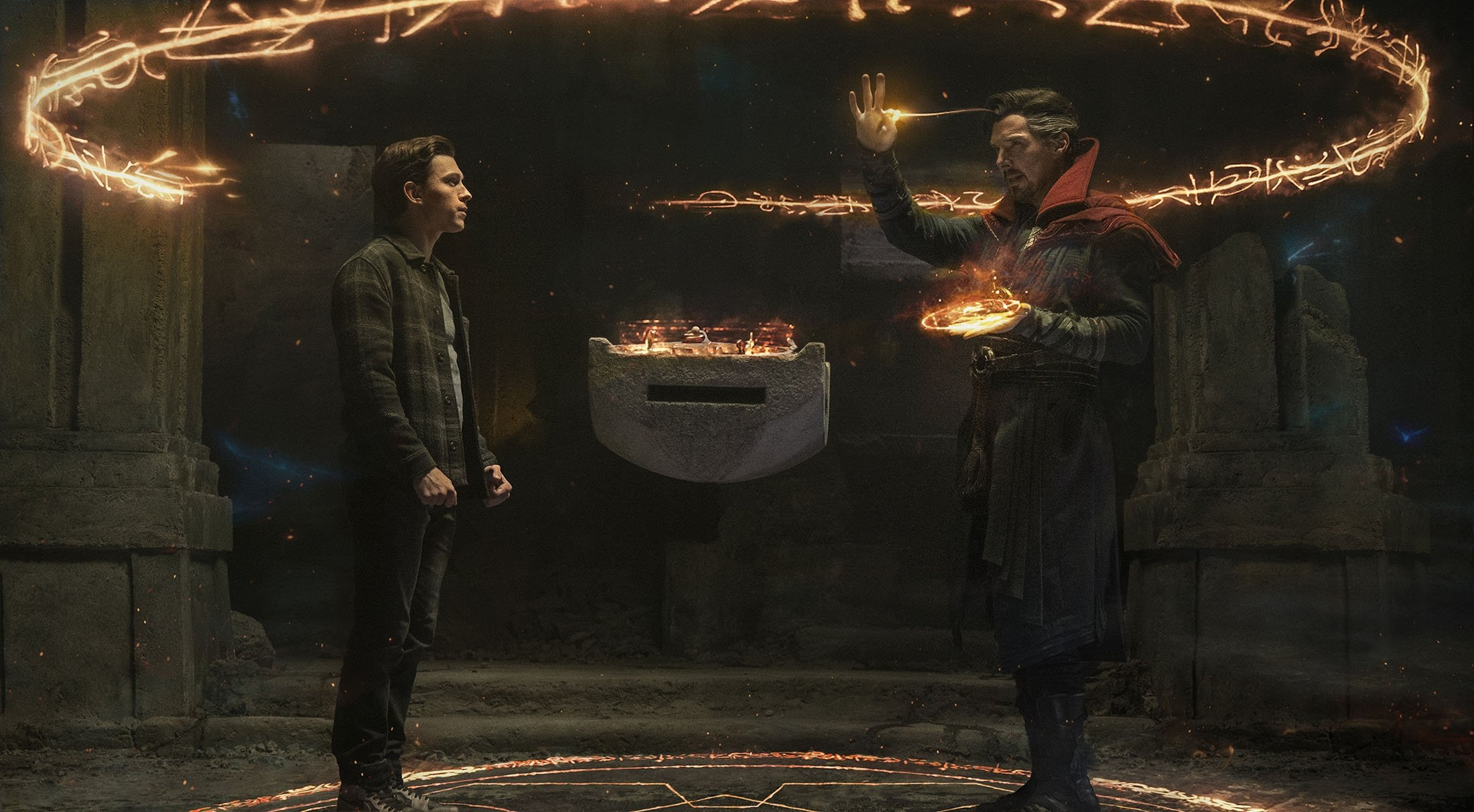 Tom Holland (L), and Benedict Cumberbatch, in a scene from the film 'Spider-Man: No Way Home.' (Sony Pictures via AP)