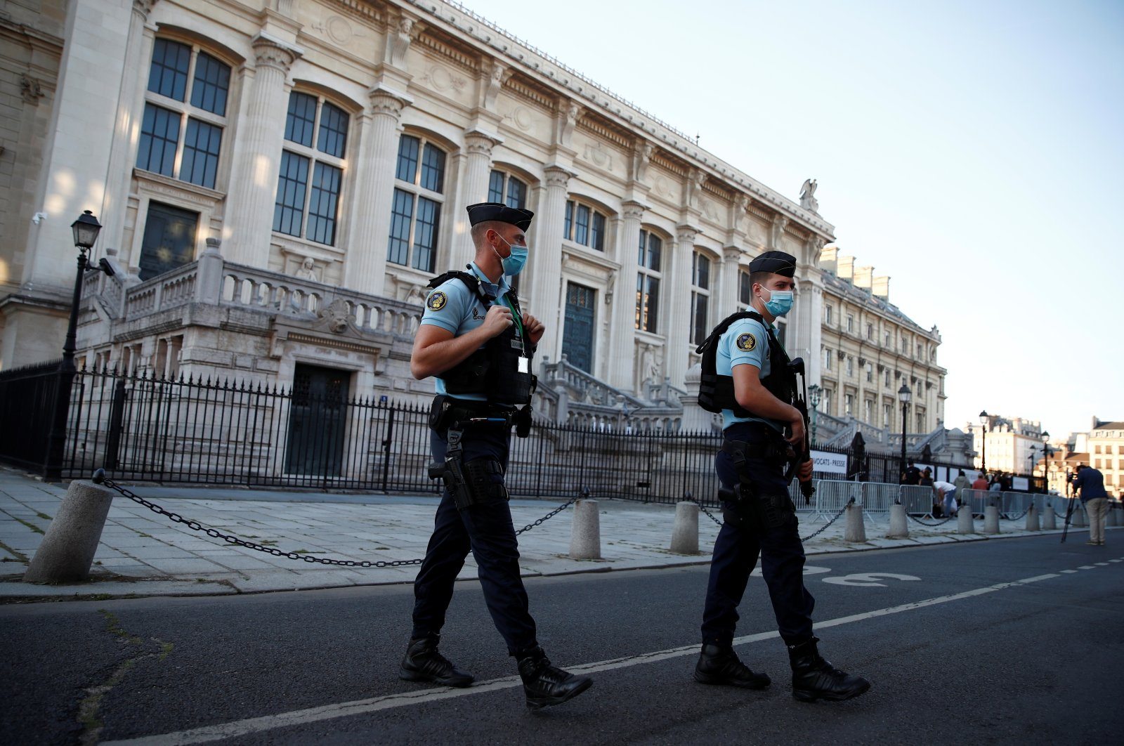 French police forces are seen near the Paris courthouse on the Ile de la Cite before the start of the trial of Paris' November 2015 attacks, in Paris, France, Sept. 8, 2021. (Reuters Photo)