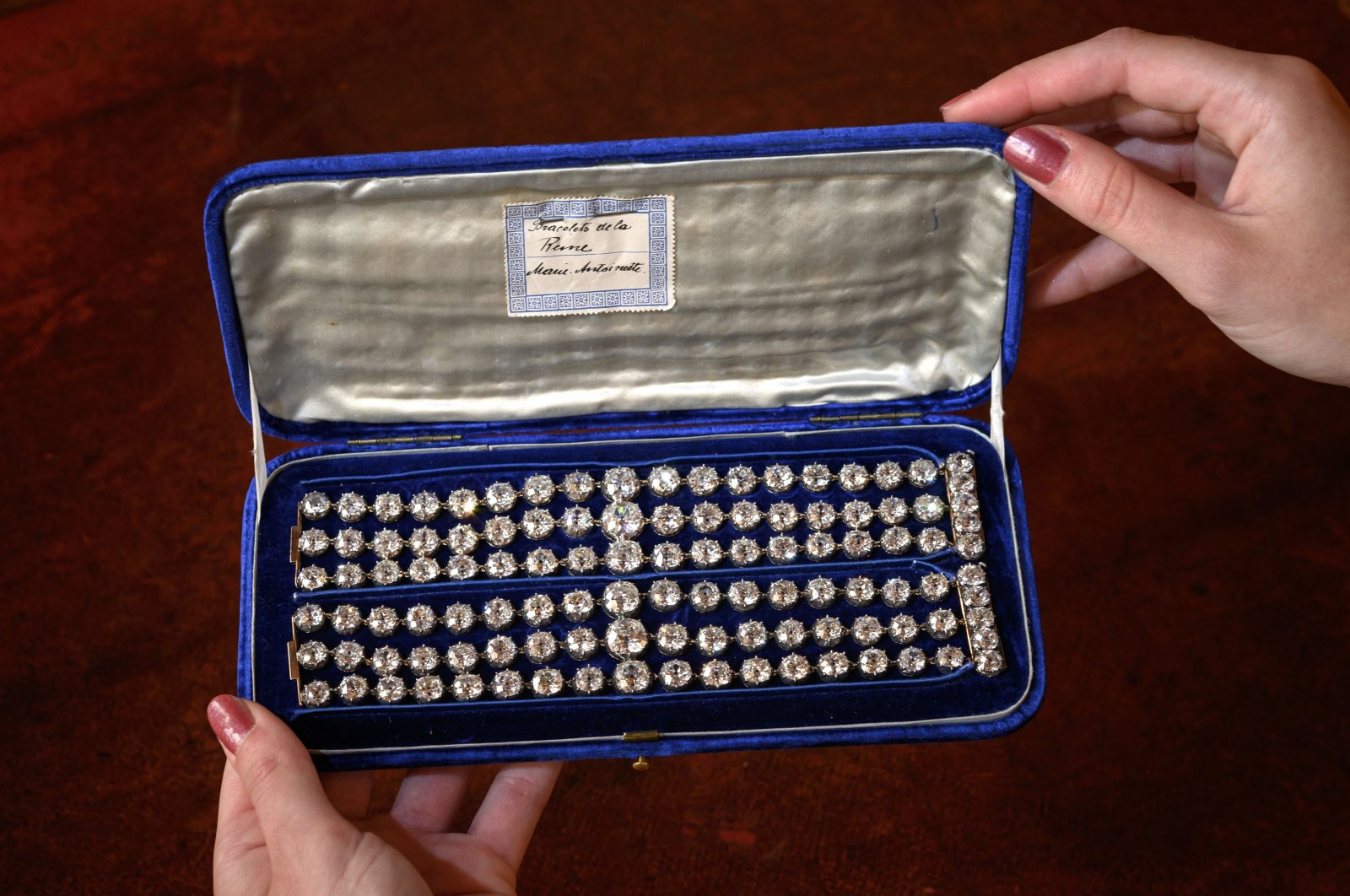This picture taken in Geneva on Sep. 6, 2021, shows two bracelets belonged to French Queen Marie-Antoinette adorned with three rows of 112 old cut diamonds. (AFP Photo)