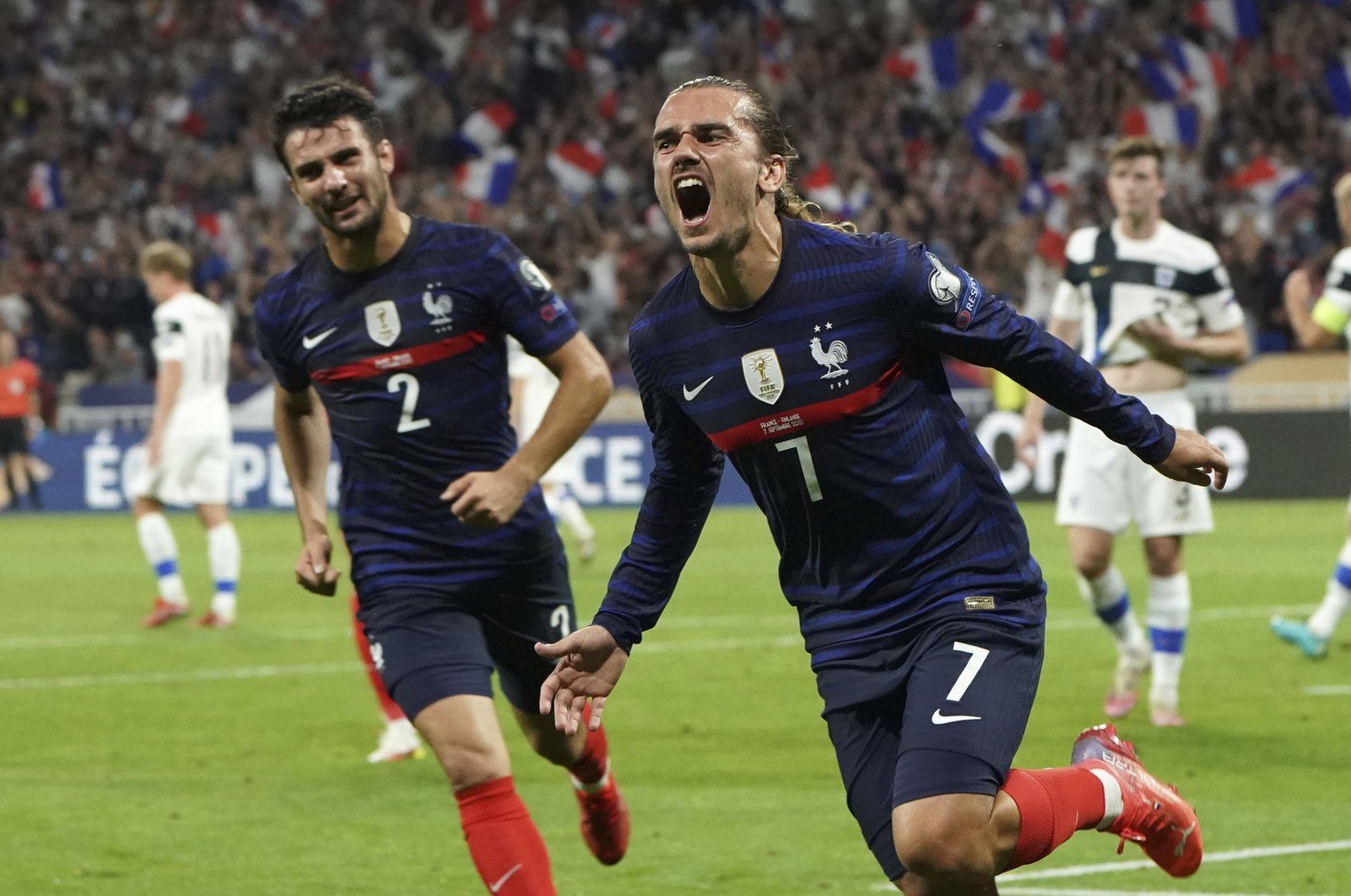 France's Antoine Griezmann celebrates after scoring against Finland in a World Cup 2022 Group D qualifier in Lyon, France, Sept. 7, 2021. (AP Photo)