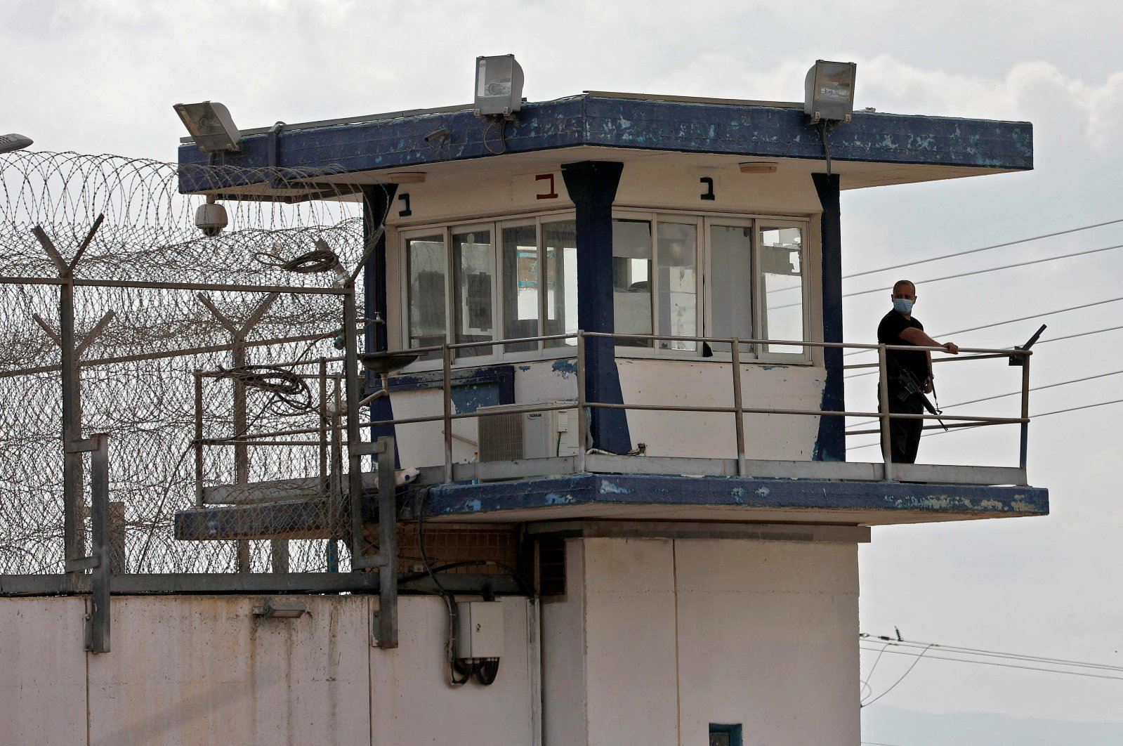 A police officer keeps watch from an observation tower at the Gilboa prison, northern Israel, Sept. 6, 2021. (AFP Photo)