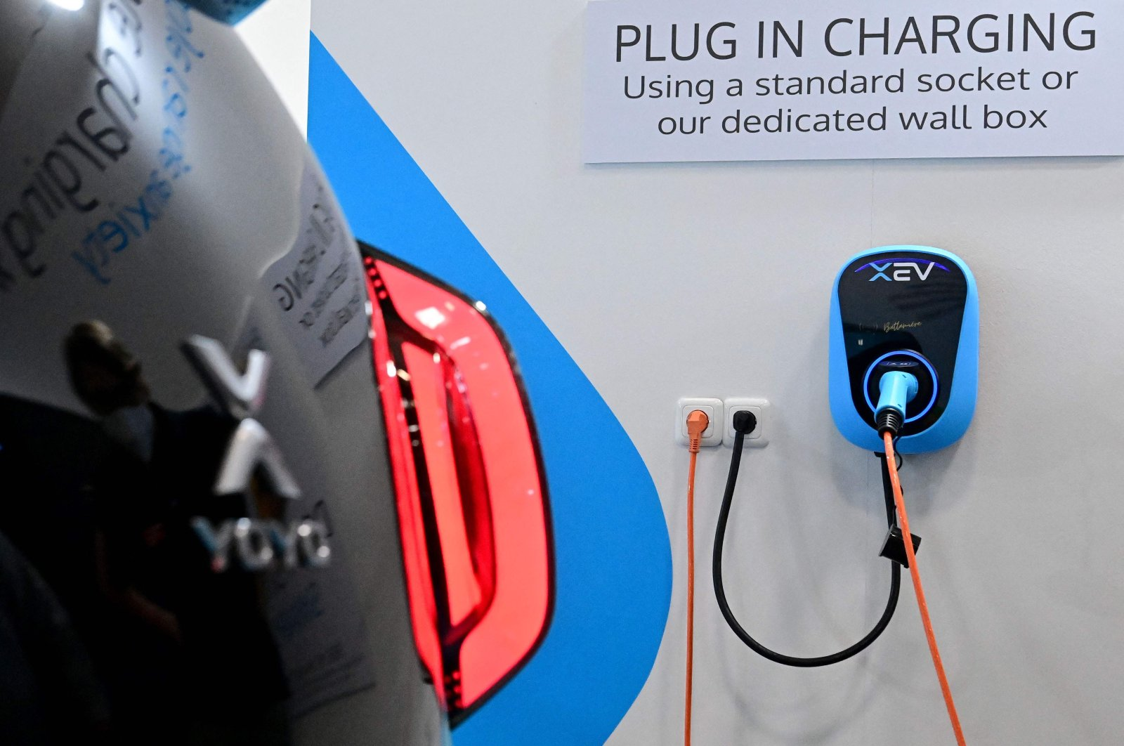 An XEV Yoyo 3D-printed electric car is being charged during a press preview at the International Motor Show (IAA), in Munich, southern Germany, Sept. 6, 2021. (AFP Photo)