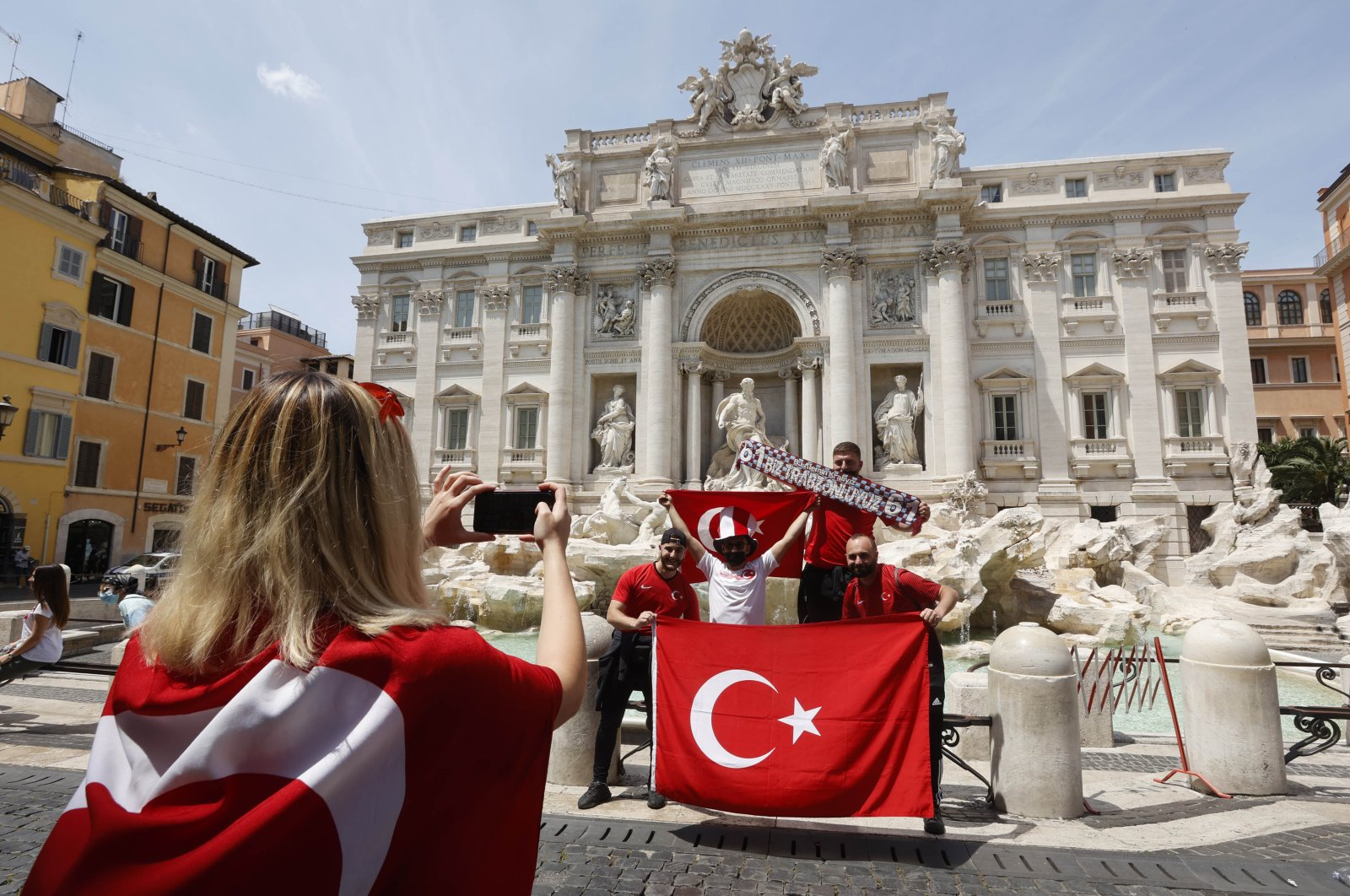 Turkish fans pose in front of Trevi fountain ahead of a national football match between Italy and Turkey, in Rome, Italy, June 11, 2021. (AA PHOTO)