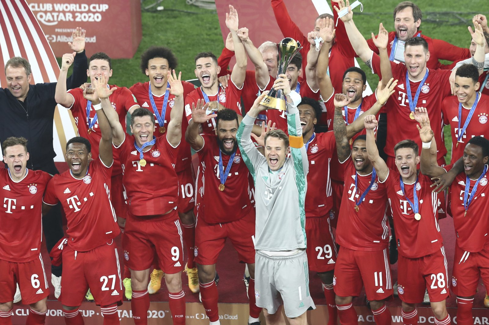 Bayern goalkeeper Manuel Neuer holds up the FIFA Club World Cup trophy after beating Tigres in the final at the Education City stadium, al Rayyan, Qatar, Feb. 11, 2021. (AP Photo)