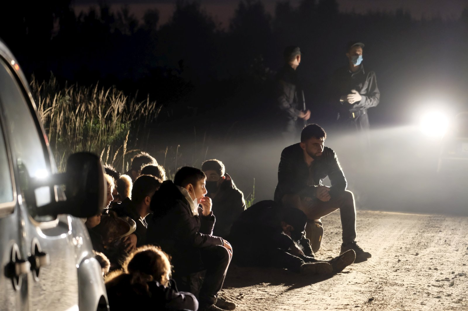 A group of illegal migrants detained in Vorzova, Latvia, Aug. 11, 2021. (EPA Photo)