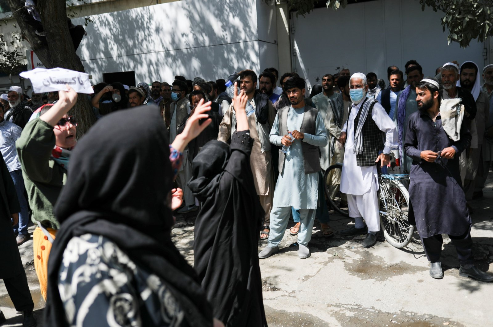 Female Afghan protesters chant toward a crowd of men during the anti-Pakistan protest in Kabul, Afghanistan, Sept. 7, 2021. (West Asia News Agency via Reuters)