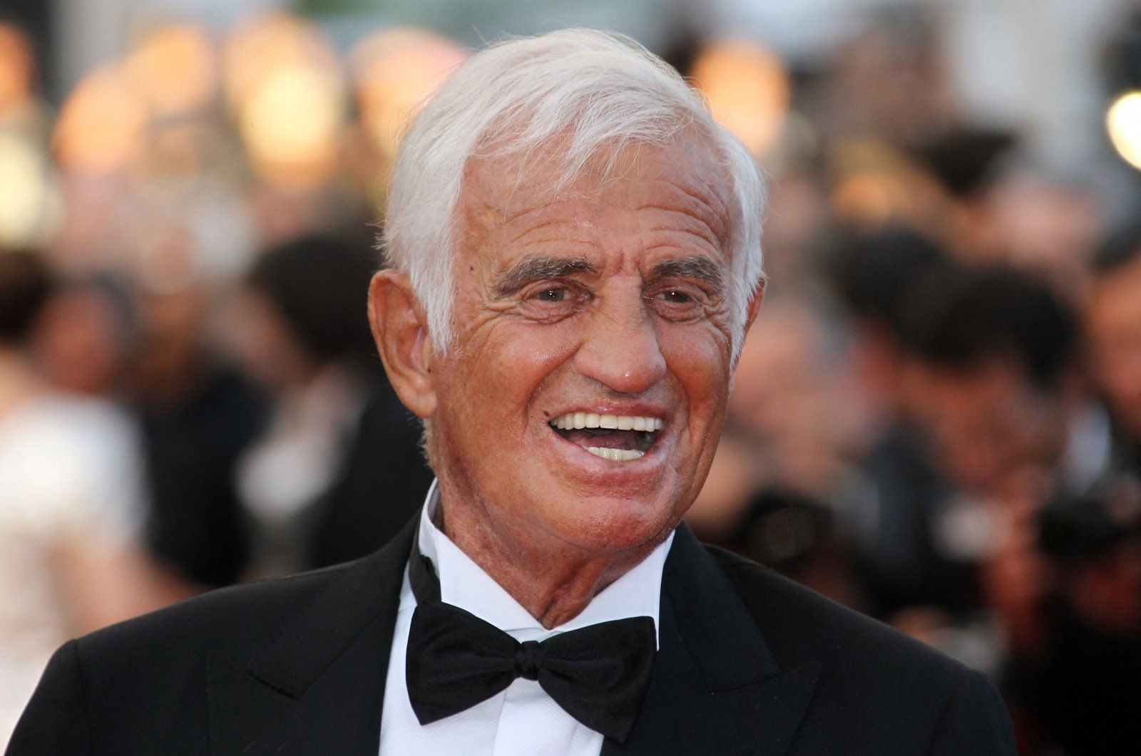 """French actor Jean-Paul Belmondo poses on the red carpet before a ceremony in his honor and the screening of """"The Beaver"""" presented out of competition at the 64th Cannes Film Festival in Cannes, southern France, May 17, 2011. (AFP File Photo)"""