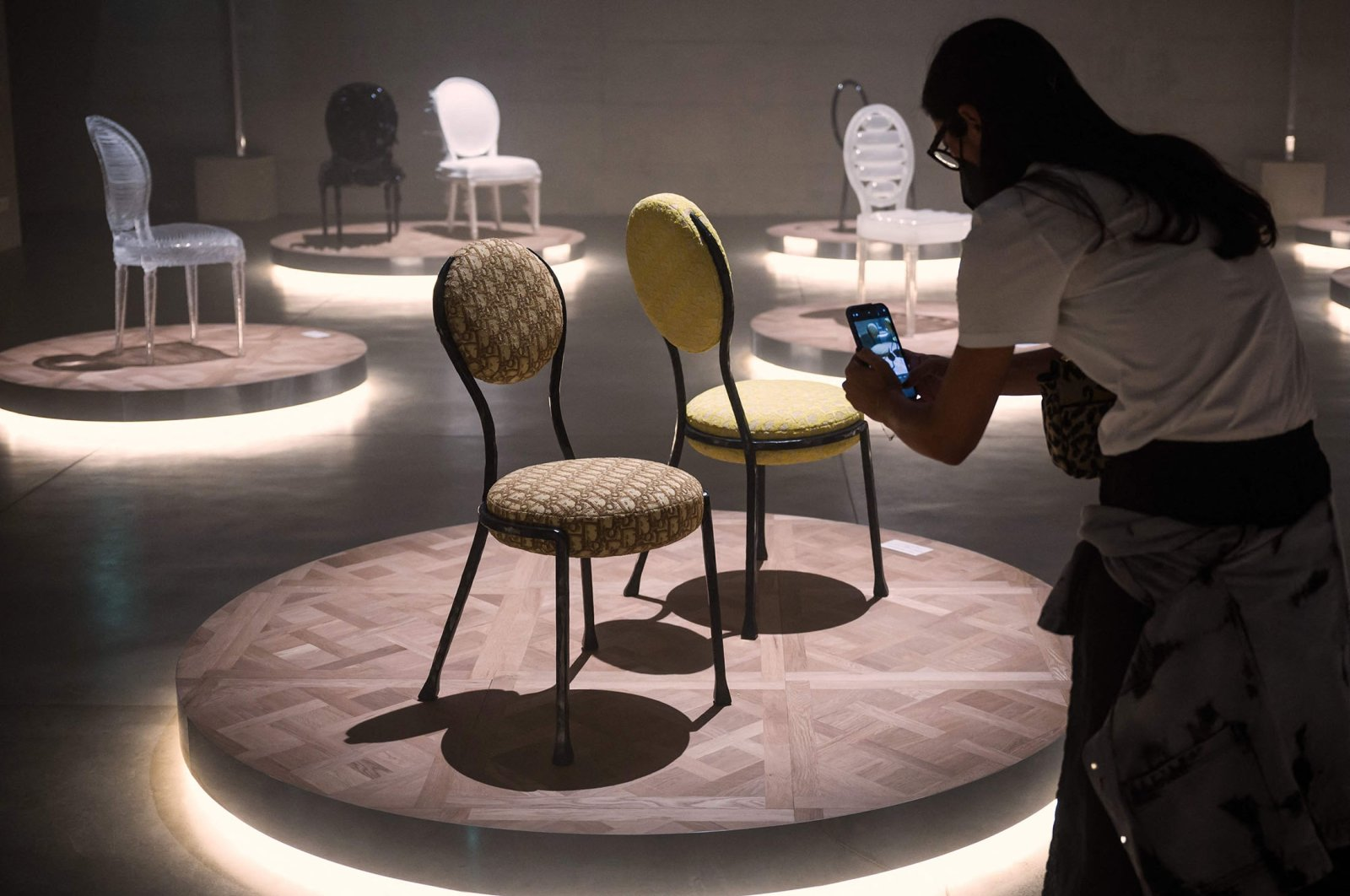 """People look at """"Monsieur et Madame Dior"""" by artist Pierre Yovanovitch displayed during the Fuorisalone 2021 design week in Palazzo Citterio, in Milan, Italy, Sept. 4, 2021. (AFP Photo)"""