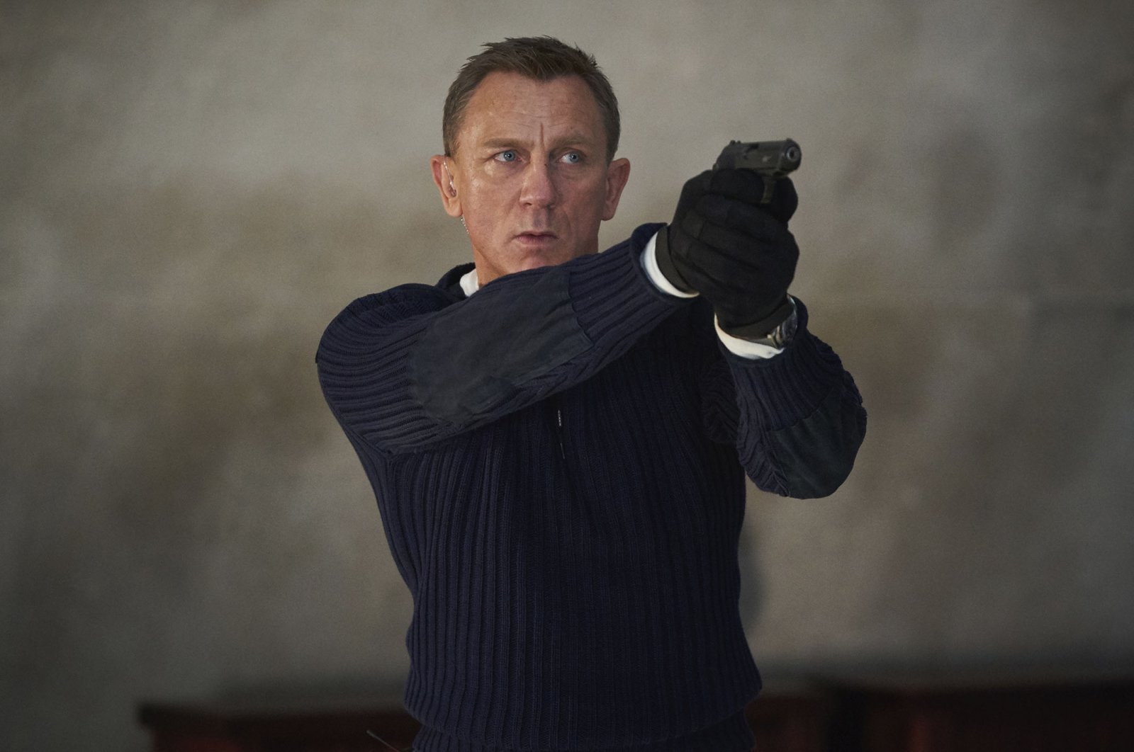 """Daniel Craig, in a scene from the film """"No Time To Die."""" (MGM via AP)"""