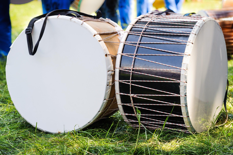 Turkish davul drums on the grass. (Shutterstock Photo)