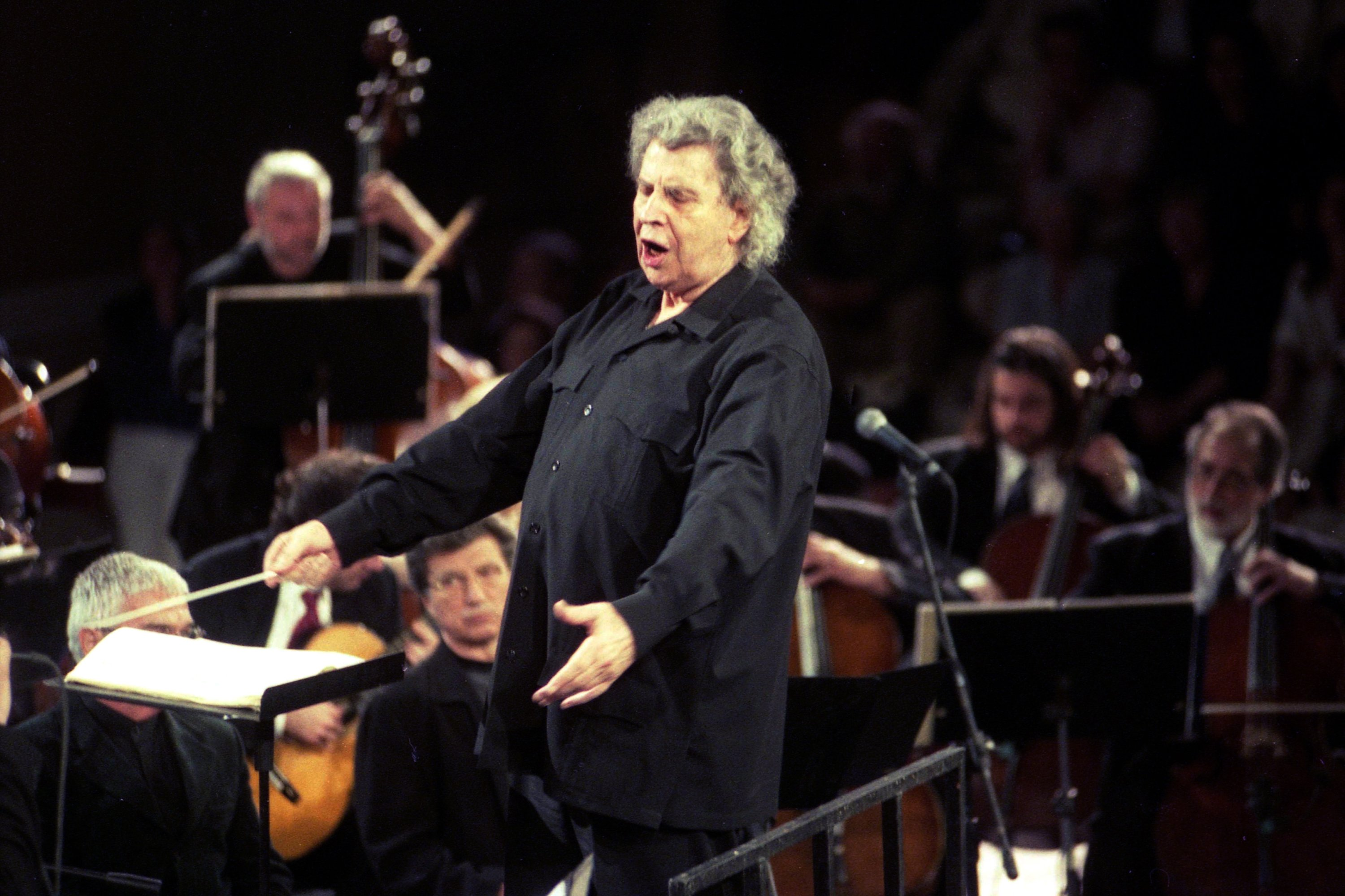Greek composer Mikis Theodorakis directs his orchestra during a rehearsal at the ancient Herodium Atticon theater at the steps of Acropolis, in Athens, Greece, May 20, 2001.