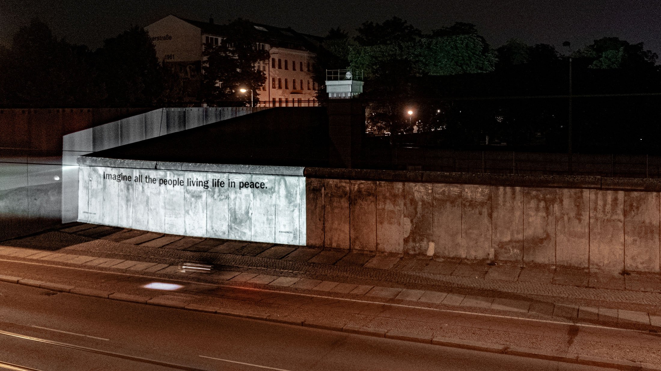 A lyric of John Lennon's and Yoko Ono's song 'Imagine' is projected on Berlin Wall to mark 50 years since the late Beatle released the famed track and album, in Berlin, Germany, Sept. 7, 2021. (Universal Music Group via Reuters)