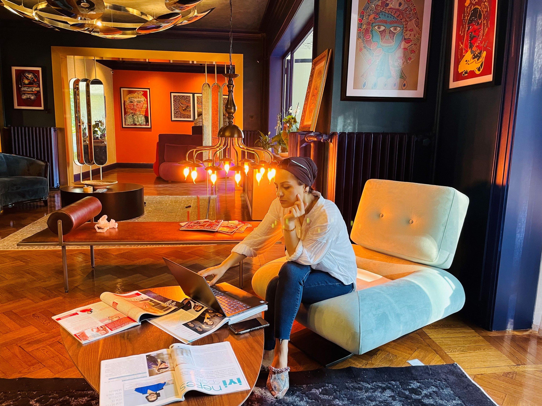 "Serra Erdoğan poses with her works at Matmazel"" (""Mademoiselle""). (Courtesy of Serra Erdoğan)"