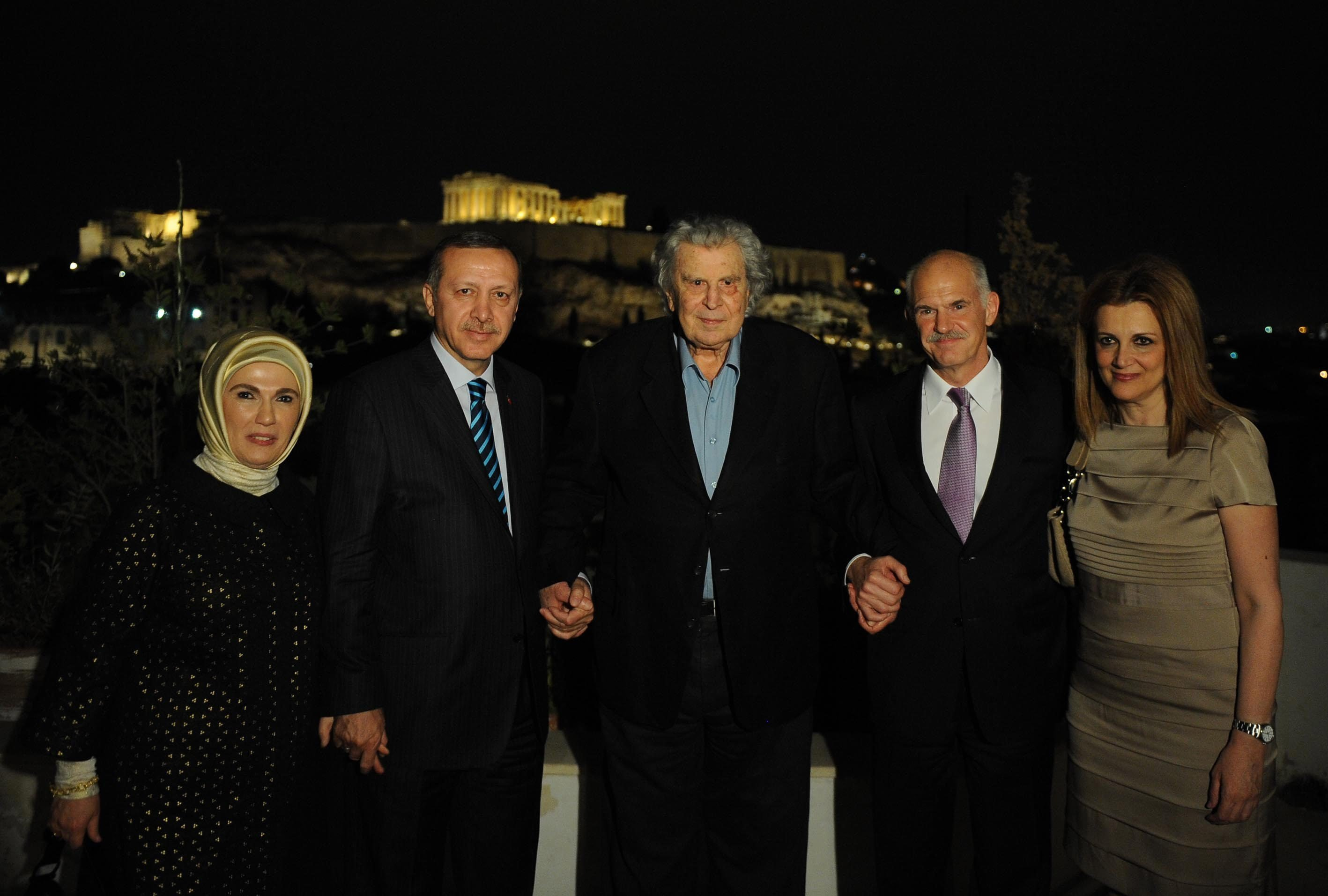 This file photo dated May 15, 2010, shows Mikis Theodorakis (C) welcoming former Greek Prime Minister George Papandreou (2nd R) and then-Turkish Prime Minister Recep Tayyip Erdoğan (2nd L) to his Athens home along with their wives during the latter's visit to Greece. (AA Photo)