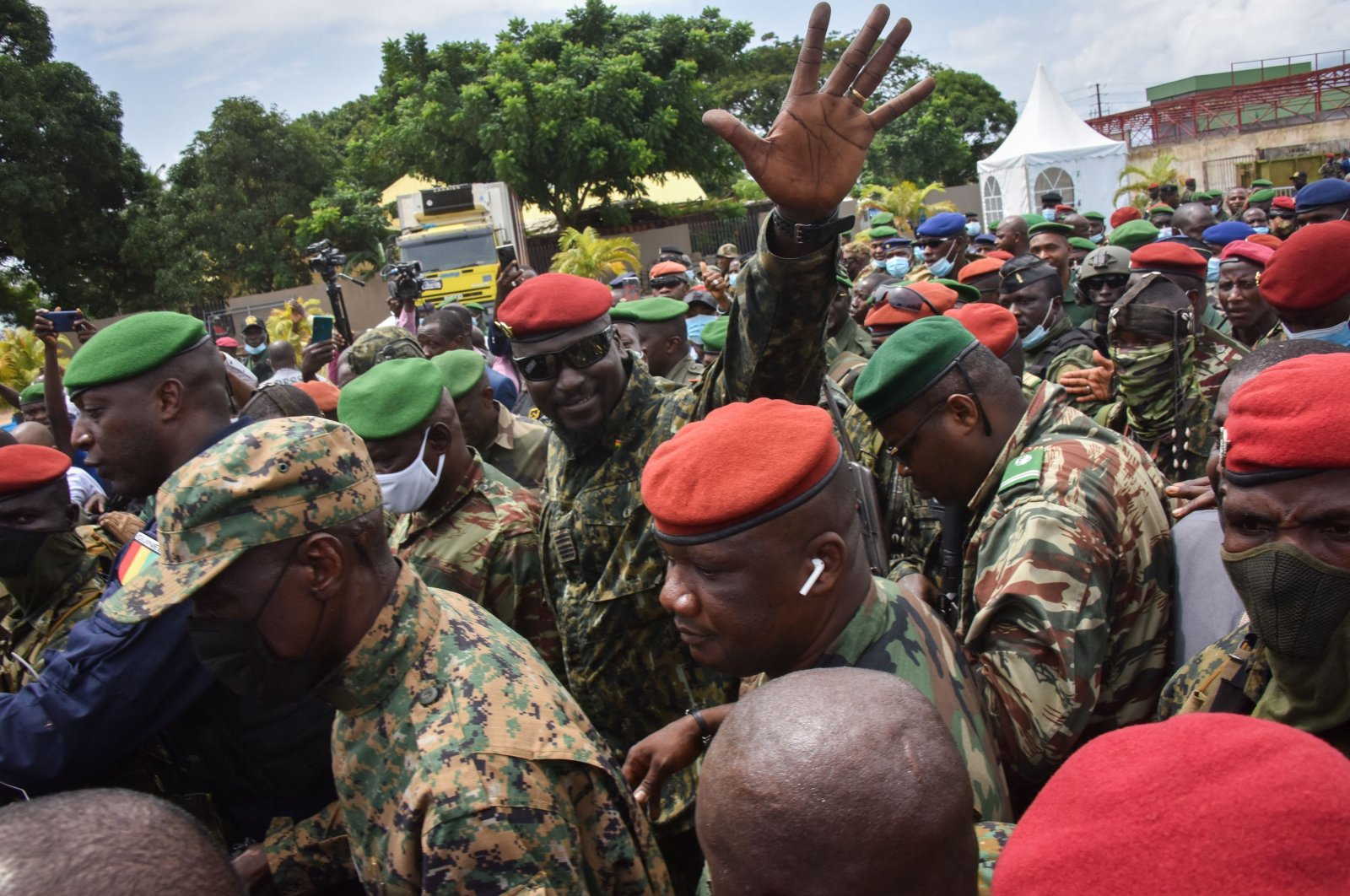 Lieutenant Colonel Mamady Doumbouya, head of the Army's special forces and coup leader, waves to the crowd as he arrives at the Palace of the People in Conakry on Sept. 6, 2021, ahead of a meeting with the Ministers of the President of Guinea, Alpha Conde. (AFP Photo)