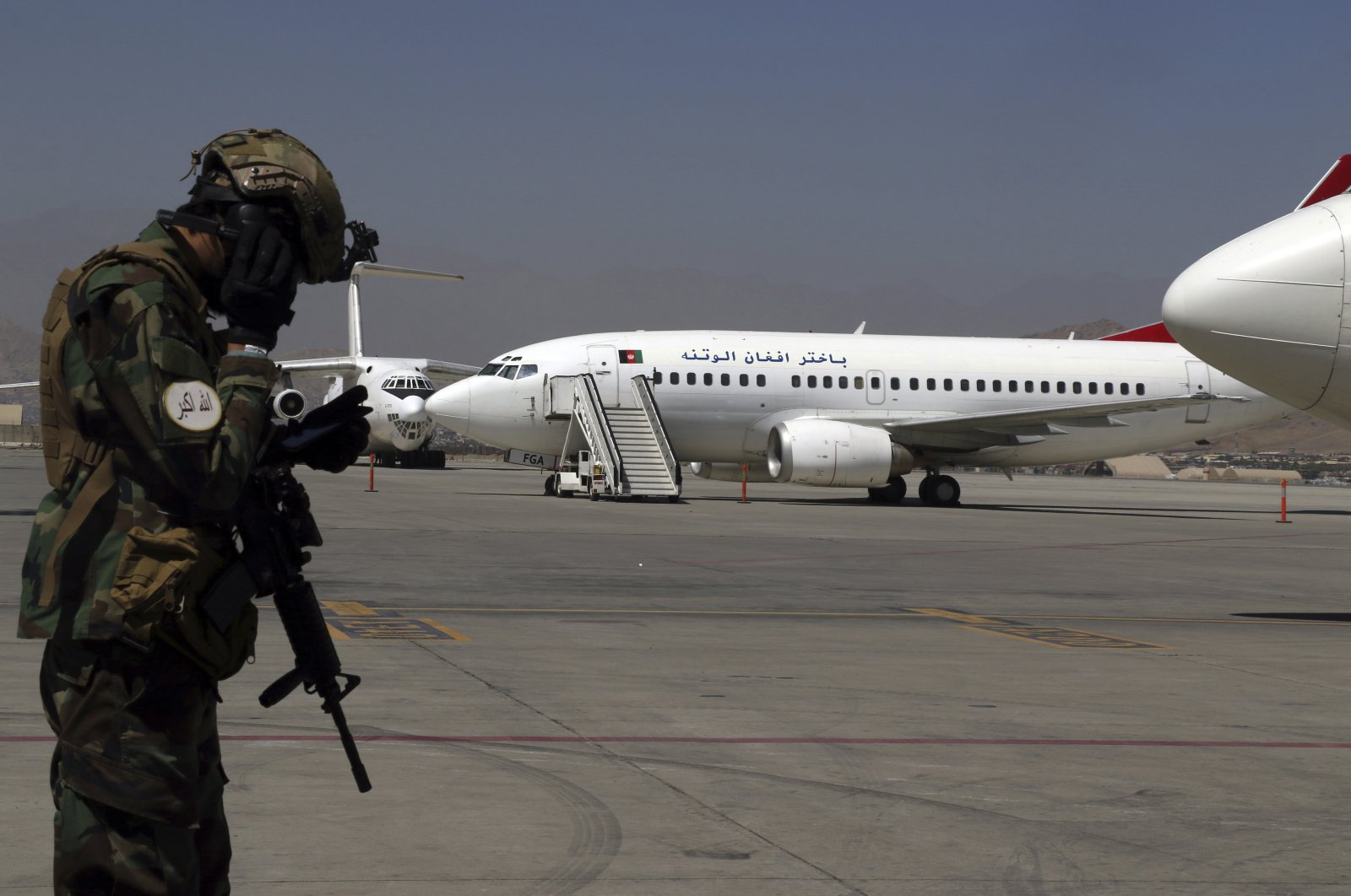 A Taliban soldier stands guard at Kabul Hamid Karzai International Airport in Kabul, Afghanistan, Sept. 5, 2021. (AP Photo)