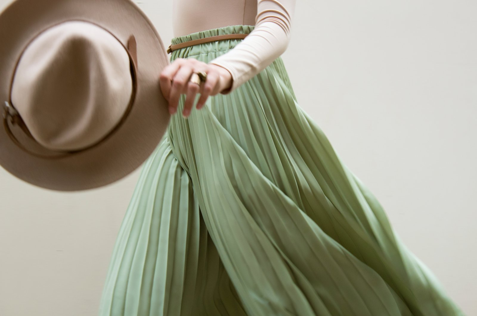 One way to wear a pleated skirt is in combination with an oversized top piece. (Shutterstock Photo)
