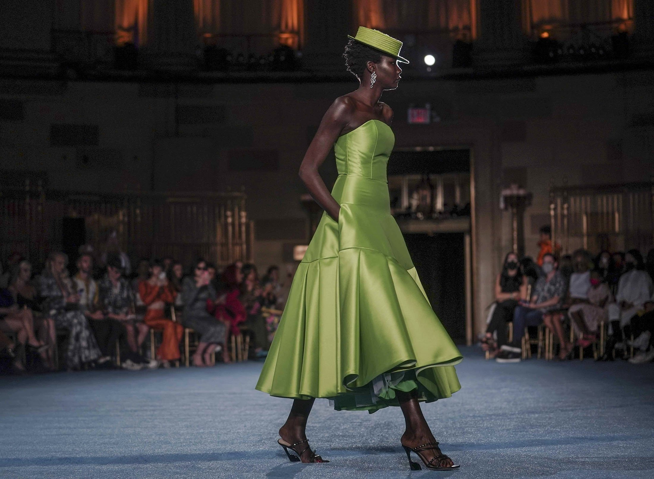 The latest fashion from Christian Siriano is modeled during New York's Fashion Week, New York, U.S., Sept. 7, 2021. (AP Photo)
