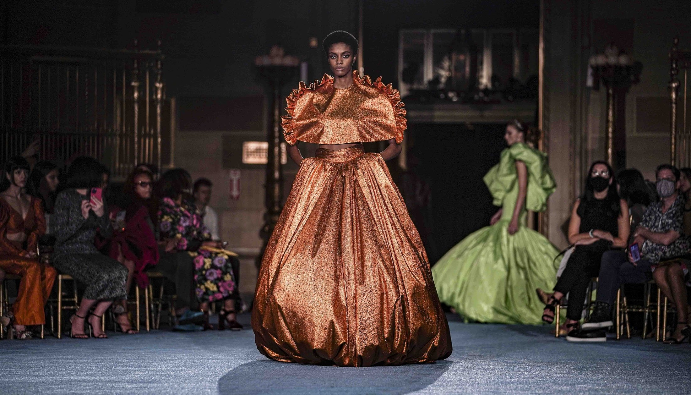 The latest fashion from Christian Siriano is modeled during New York Fashion Week, New York, U.S., Sept. 7, 2021. (AP Photo)
