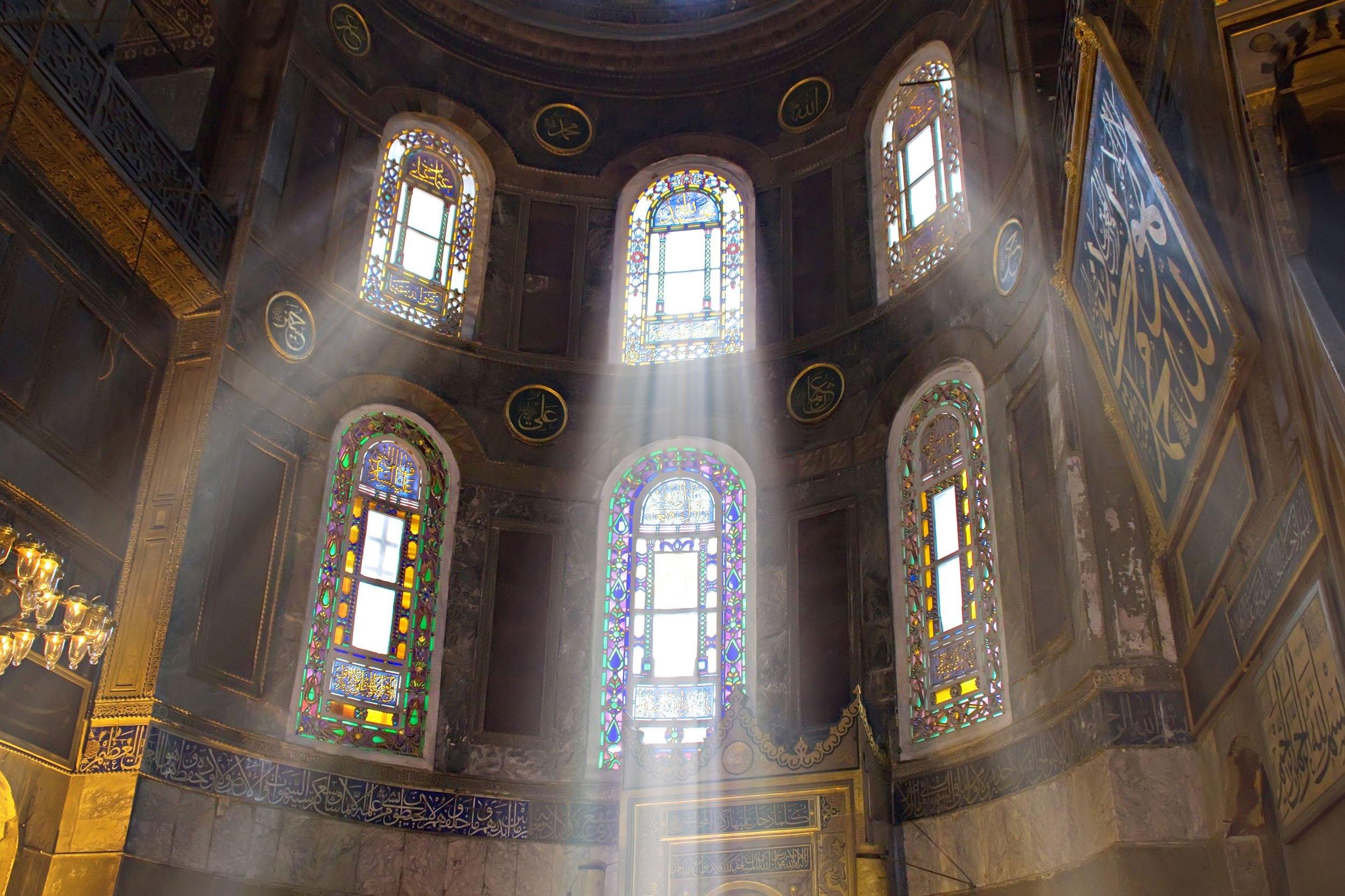 Sun shines through the glass in the Hagia Sophia Grand Mosque in Sultanahmet,Istanbul, Turkey. (Shutterstock Photo)