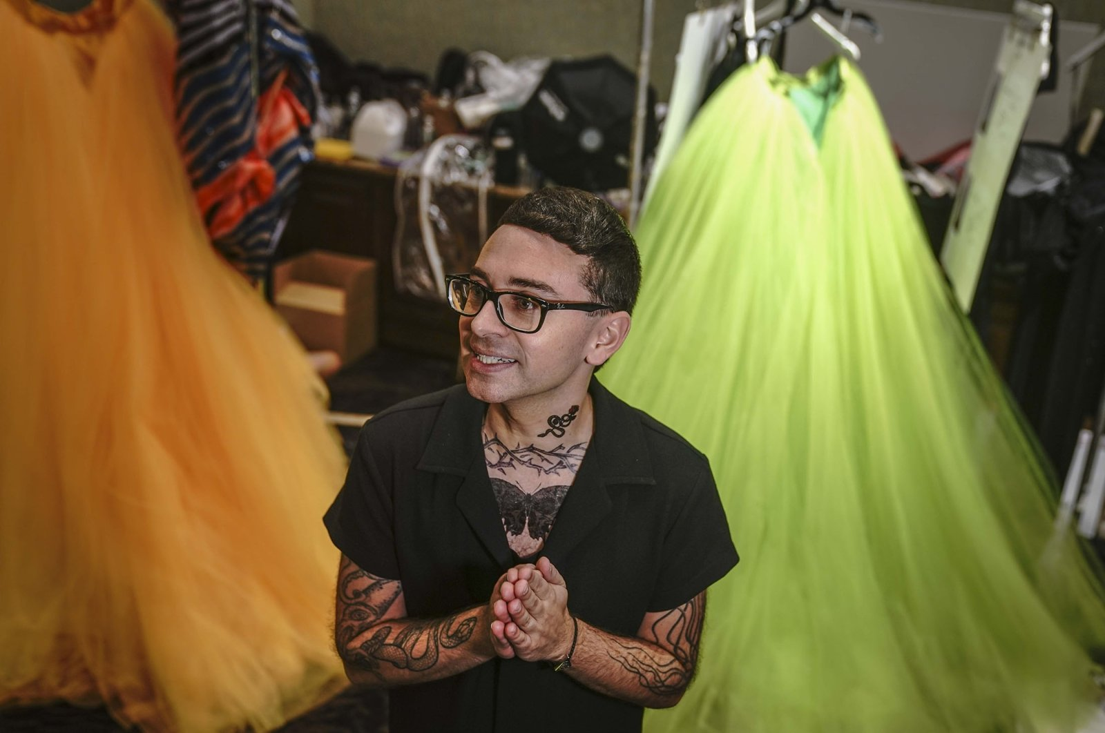 Christian Siriano speaks during a backstage interview before unveiling his latest fashion during New York's Fashion Week, New York, U.S., Sept. 7, 2021. (AP Photo)