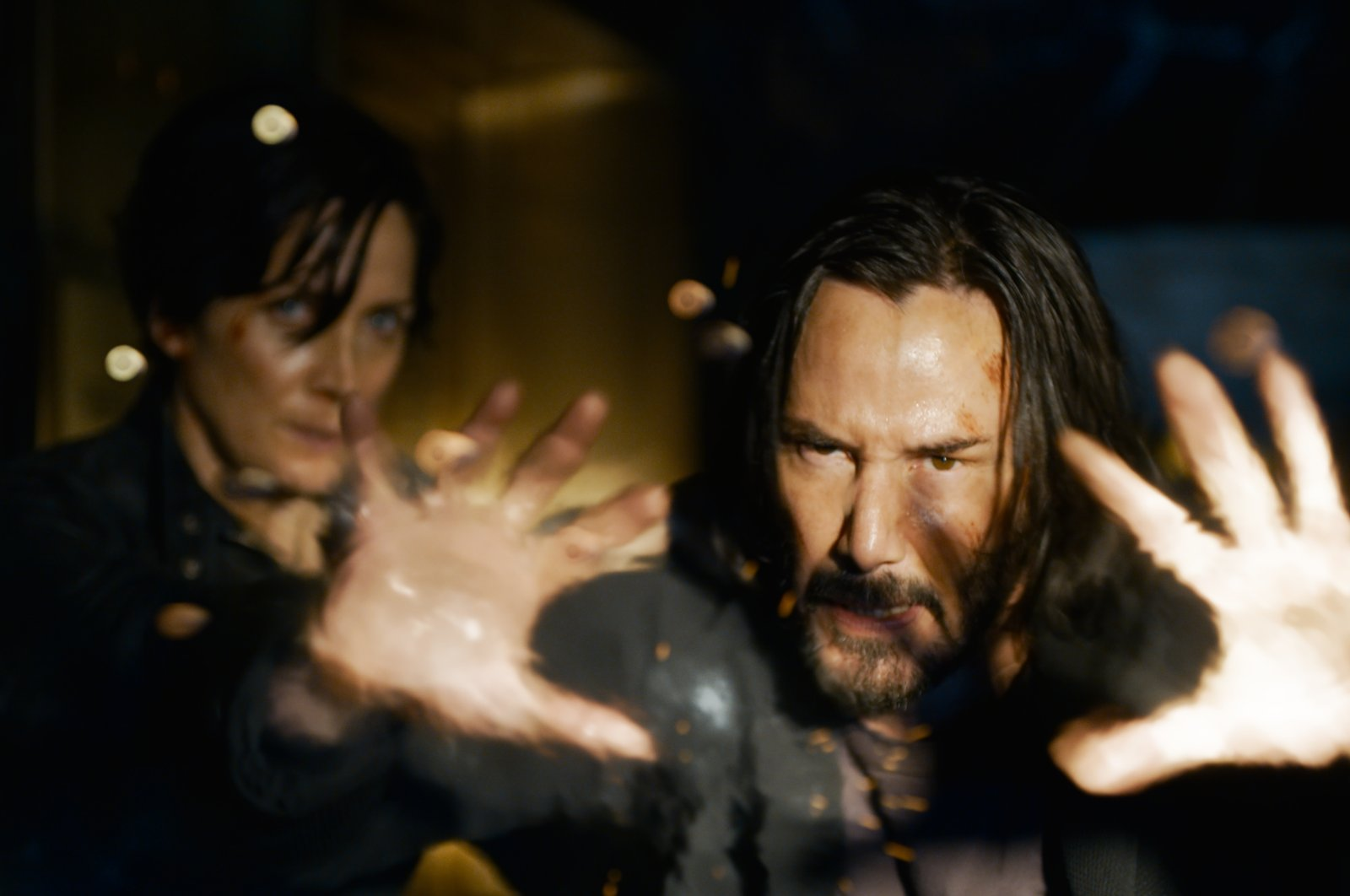 """Carrie-Anne Moss returns as Trinity and Keanu Reeves as Neo in the """"The Matrix Resurrections"""" arriving 20 years after """"The Matrix"""" trilogy concluded. (dpa Photo)"""
