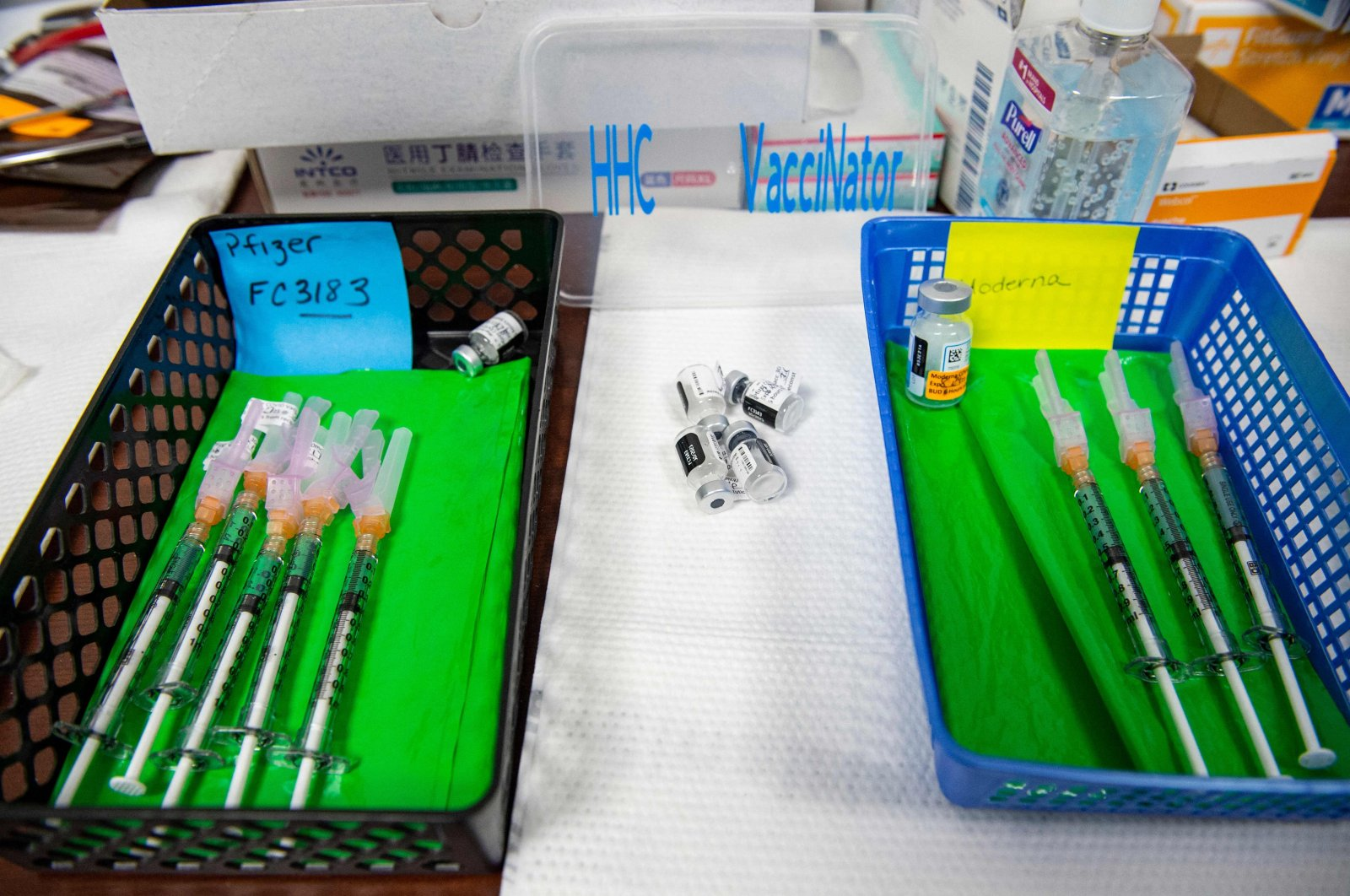 Pfizer-BioNTech's (L) andModerna'sCOVID-19 vaccines, both developed with mRNA technology,sit in baskets at the vaccine clinic at Hartford Hospital in Hartford, Connecticut, U.S., Aug. 24, 2021. (AFP Photo)