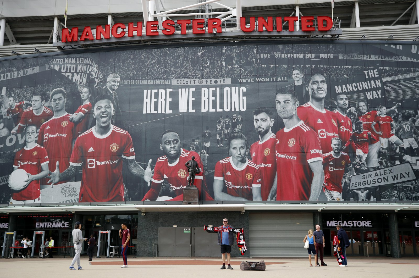 A picture of Cristiano Ronaldo with teammates is displayed on the outside of Old Trafford, in Manchester, Britain, Sept. 9, 2021. (REUTERS PHOTO)