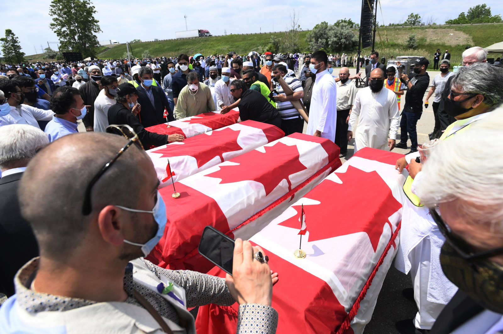 Caskets draped in Canadian flags arrive at a funeral for the four Muslim family members killed in a deadly vehicle attack, at the Islamic Centre of Southwest Ontario in London, Ont., on Saturday, June 12, 2021. (AP File Photo)