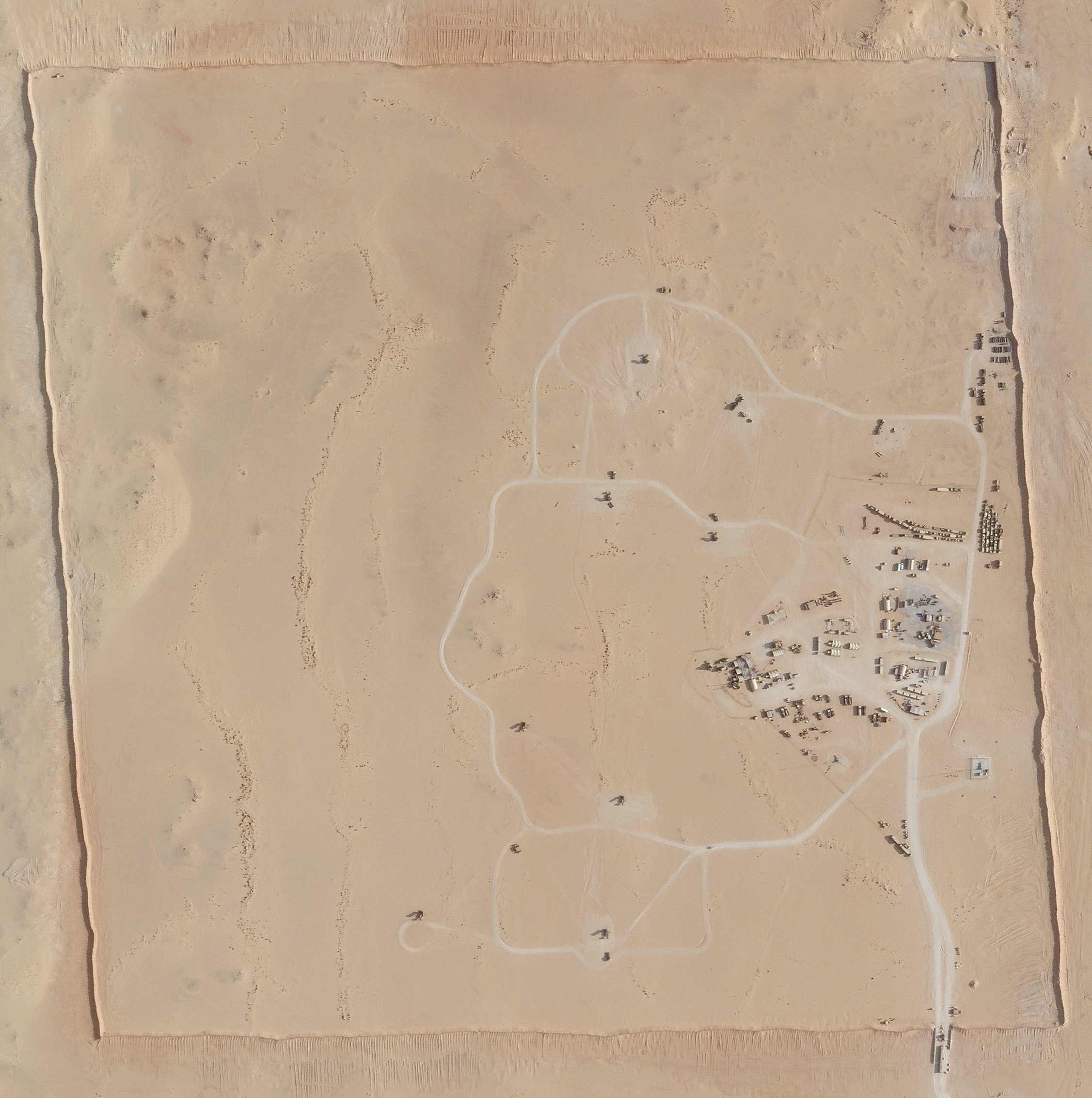 In this satellite photo provided by Planet Labs Inc., an area of Prince Sultan Air Base in Saudi Arabia sees Patriot missile batteries stationed with one advanced Terminal High Altitude Air Defense unit on Aug. 9, 2021. (Planet Labs Inc. via AP)