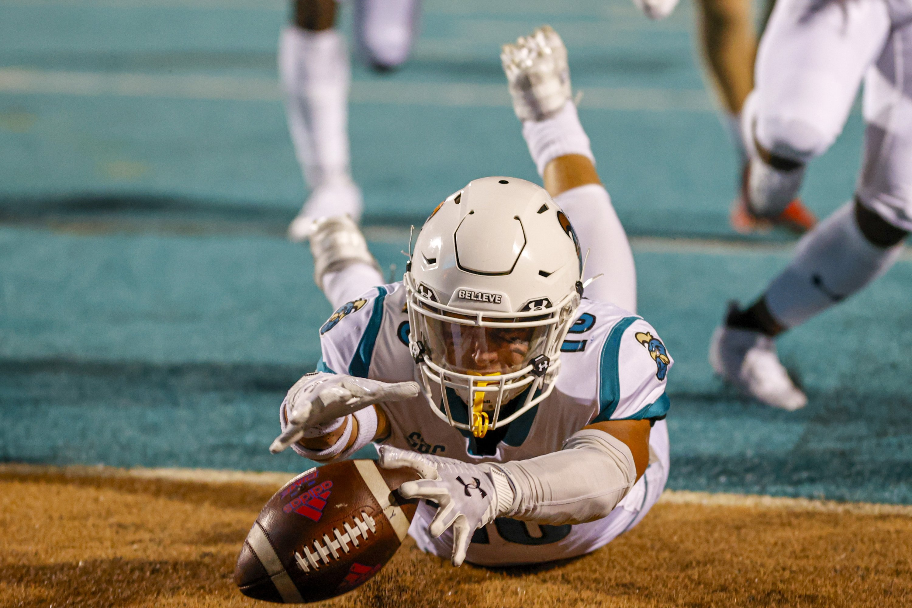 Coastal Carolina safety Alex Spillum dives on the ball in the end zone for a touchdown after he blocked a Kansas punt during the first half of an NCAA college football game in Conway, South Carolina, U.S., Sept. 10, 2021. (AP Photo)