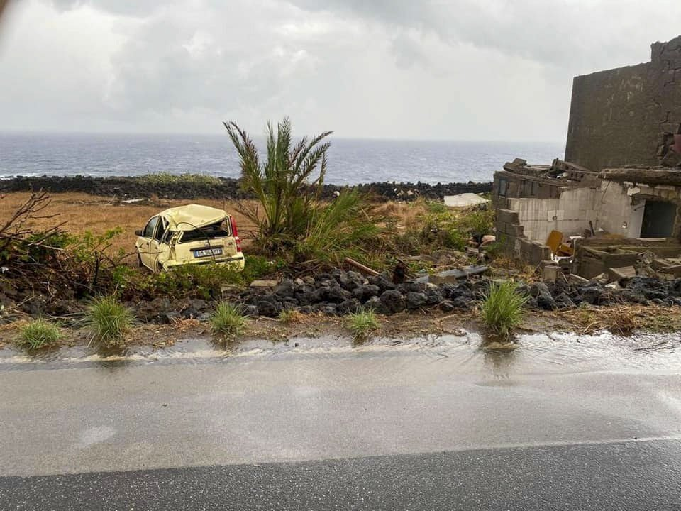 The wreckage of a car that was swiped by a tornado lays on a road on the island of Pantelleria, Sicily, Italy, Sept. 10, 2021. (Protezione Civile via AP)
