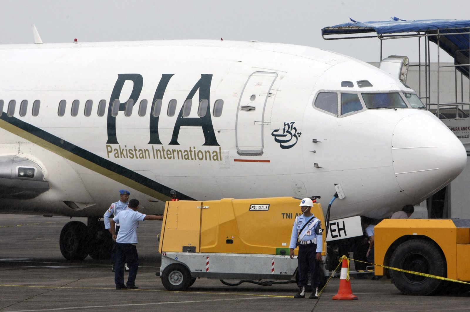 A Pakistan International Airlines passenger jet is parked on the tarmac at a military base in Makassar, Indonesia, March 7, 2011. (AP File Photo)