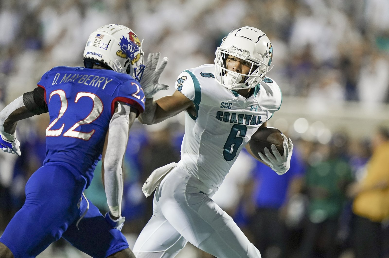 Coastal Carolina Chanticleers wide receiver Jaivon Heiligh (6) moves the ball against Kansas Jayhawks cornerback Duece Mayberry (22) during action in the first quarter at Brooks Stadium, Conway, South Carolina, U.S., Sept. 10, 2021. (USA TODAY Sports via Reuters)