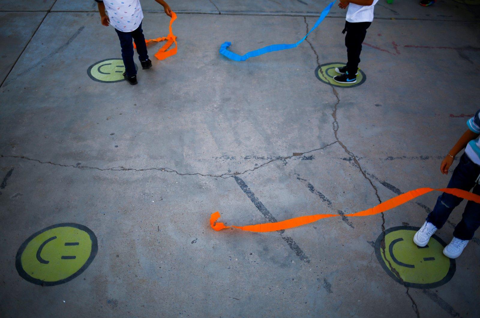 Smile emoticons are seen on the floor of a kindergarten, Ciudad Juarez, Mexico, Aug. 30, 2021. (Reuters Photo)