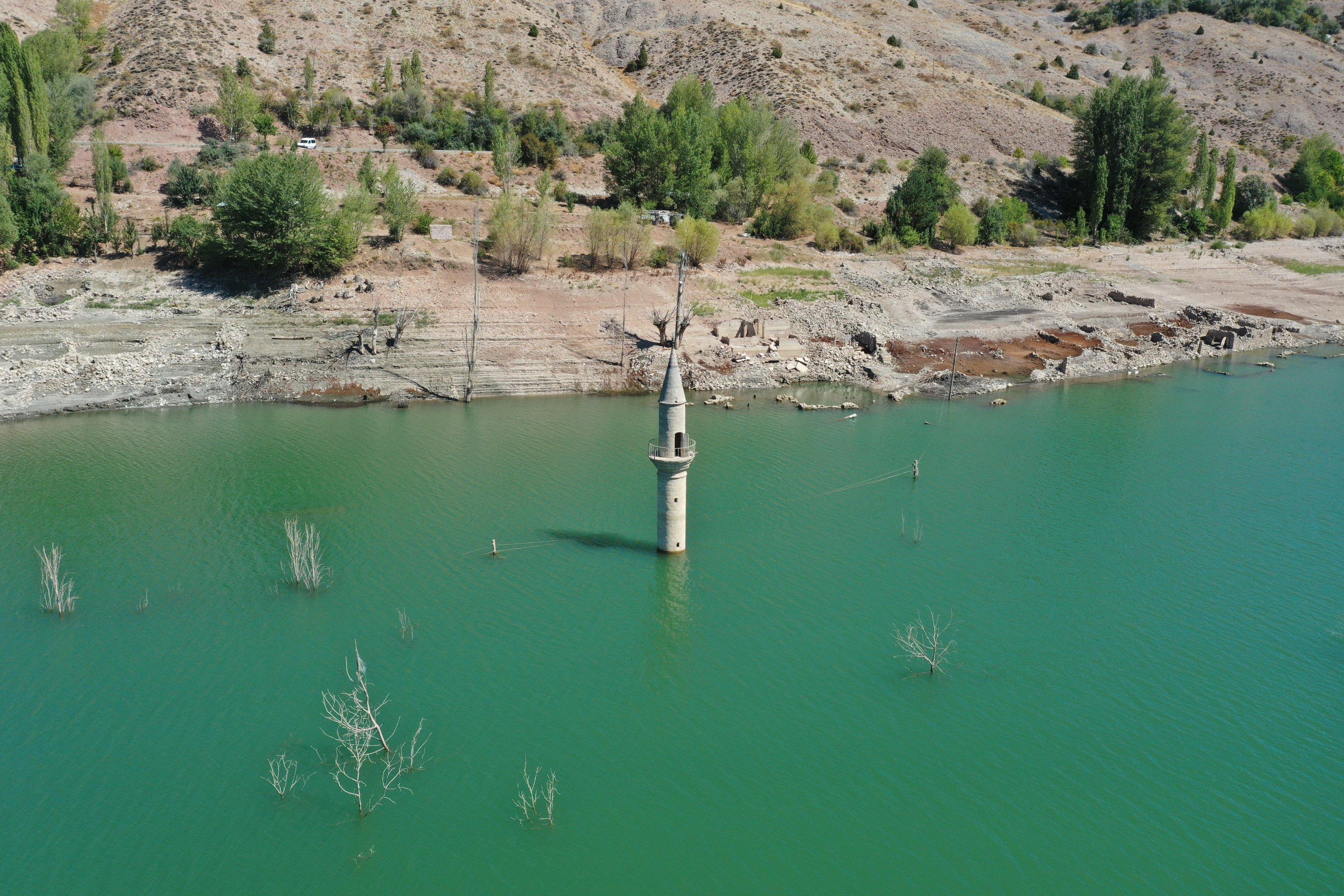 A minaret once buried underwater emerged in Pusat village amid a drought, in Sivas, central Turkey, Sept. 12, 2021. (AA PHOTO)