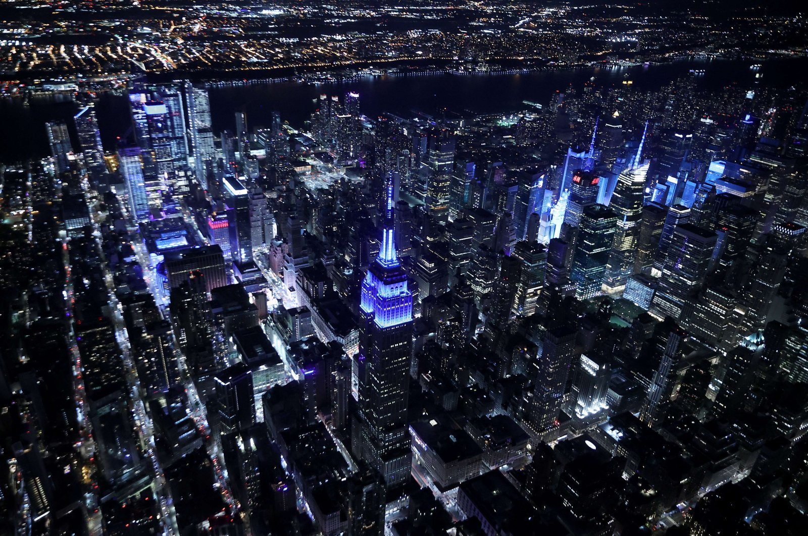 Buildings in Midtown Manhattan are bathed in blue light in commemoration of the 20th anniversary of the 9/11 terror attacks, New York City, the U.S., Sept. 11, 2021. (Chip Somodevilla / Getty Images / AFP)