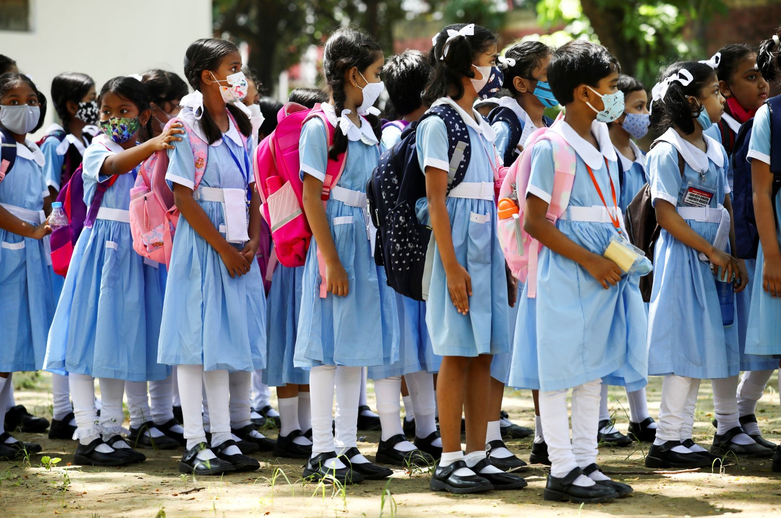 Students stand in queues after school hours at the Viqarunnisa Noon School & College after the government has withdrawn restrictions on educational institutions following a decrease in the number of cases of coronavirus disease (COVID-19) in Dhaka, Bangladesh, Sept. 12, 2021. (Reuters Photo)